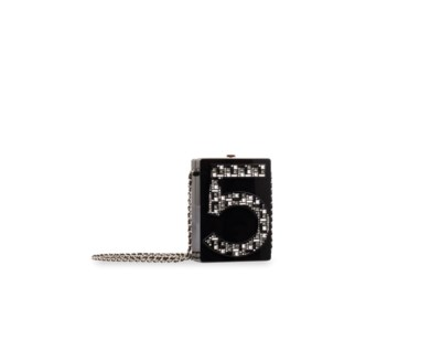 CHANEL. A BLACK LUCITE & CRYST