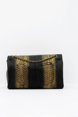 CHANEL. A BLACK & GOLD PYTHON