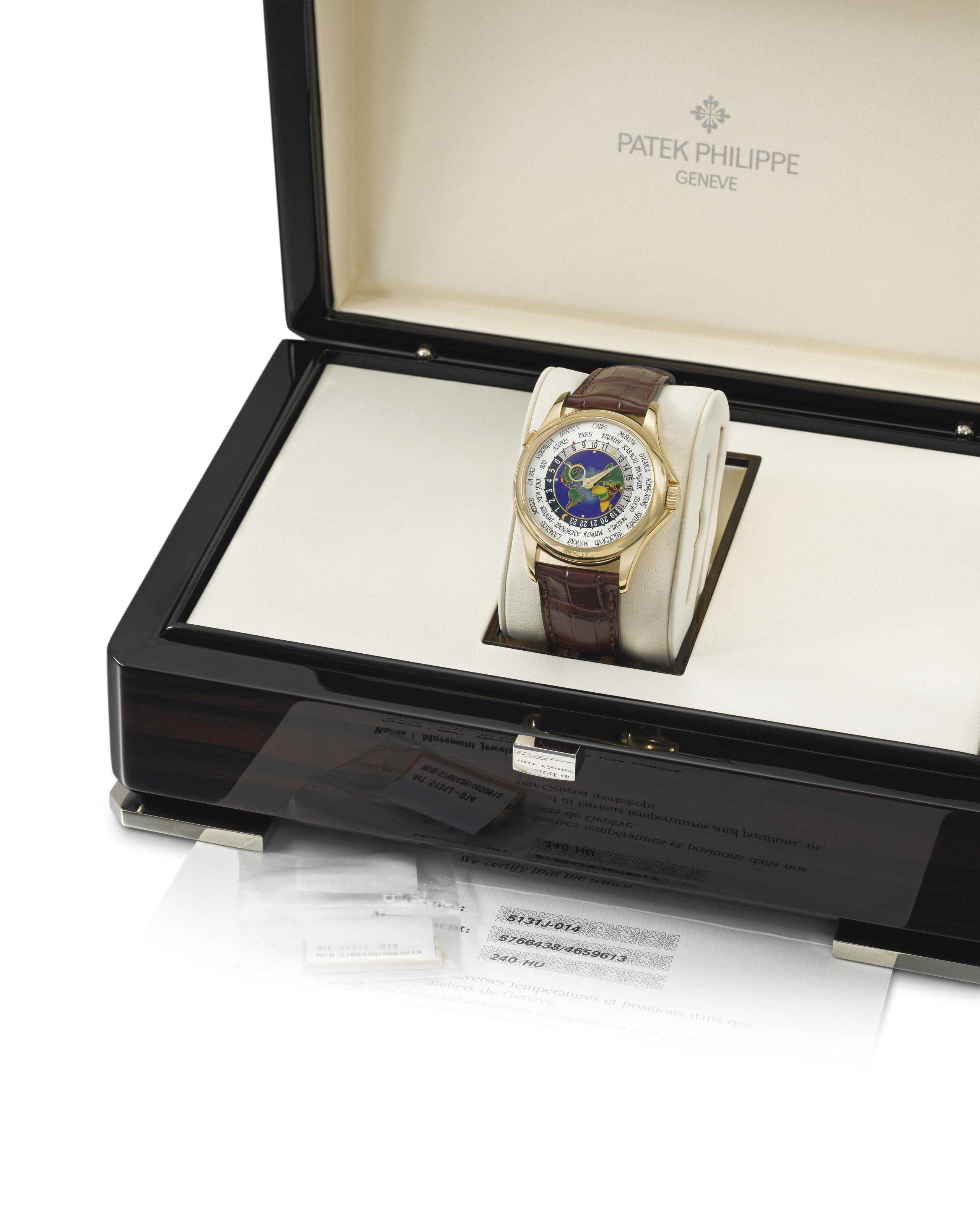 Patek Philippe A very fine and rare 18K gold automatic world...