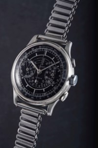 """Universal. A fine, very attractive and extremely rare large stainless steel """"staybrite"""" single-button two column wheel chronograph wristwatch with additional stop and restart button, black sector dial and oversized registers"""