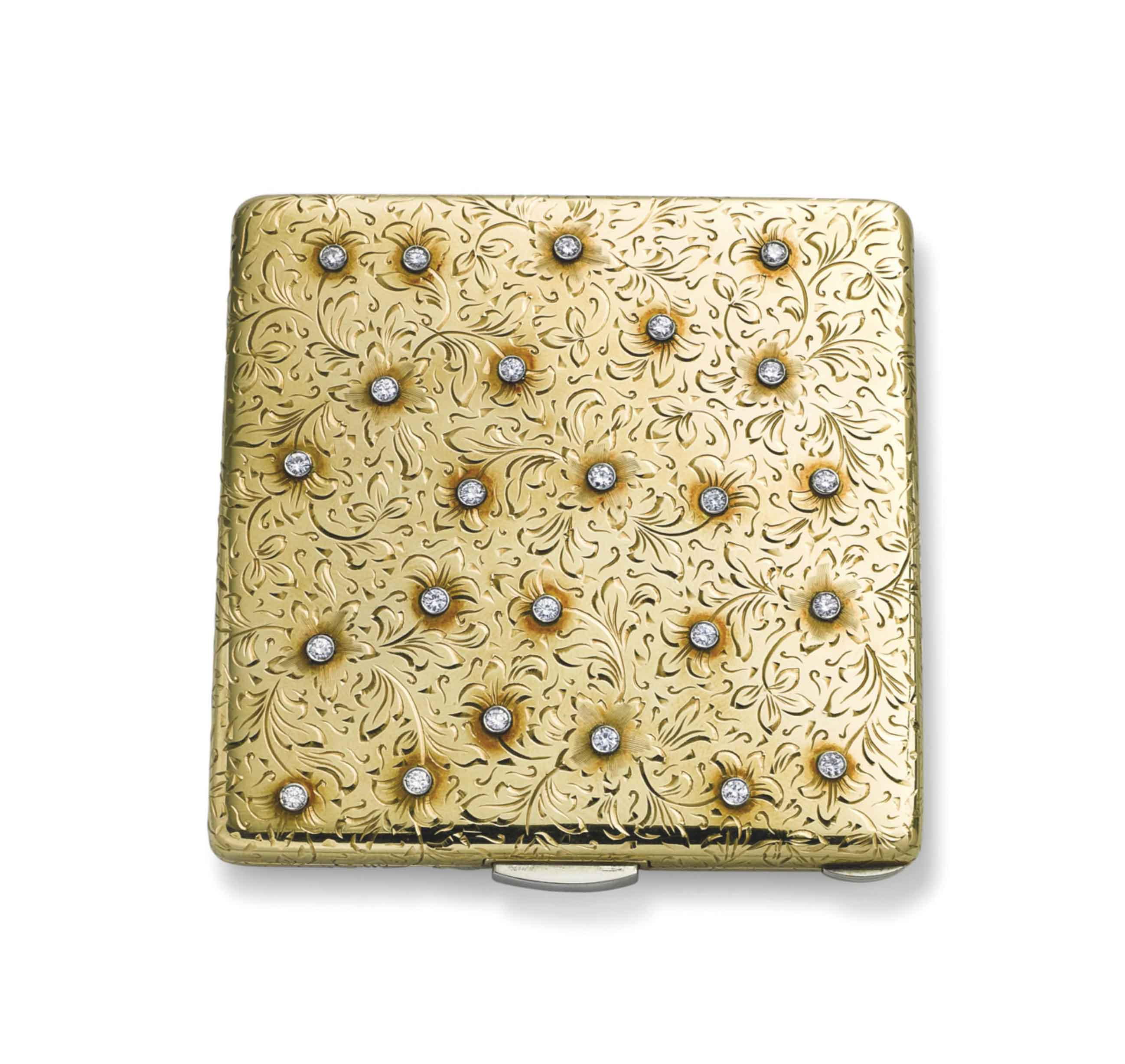 A GOLD AND DIAMOND COMPACT