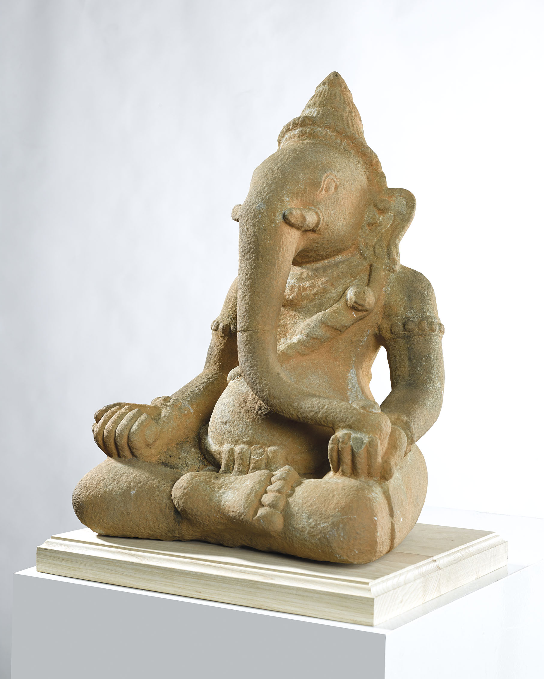A STONE FIGURE OF GANESH