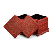 A CARVED CINNABAR LACQUER 'DOU