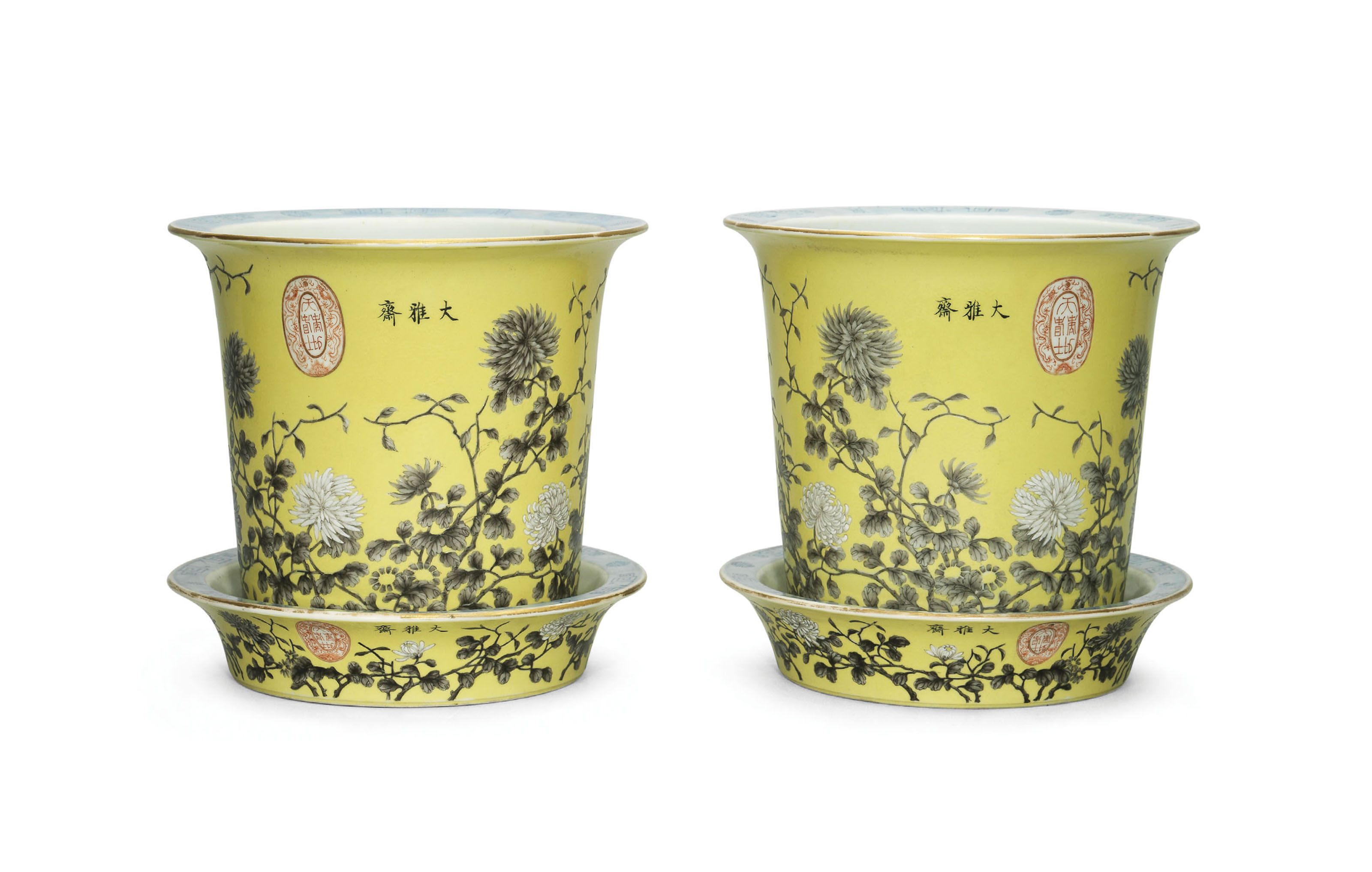 A PAIR OF YELLOW-GROUND GRISAILLE-DECORATED JARDINIERES AND STANDS