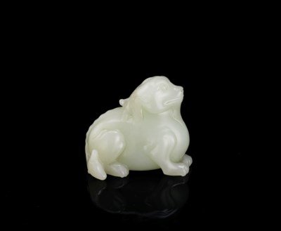 A WHITE JADE CARVING OF A MYTH