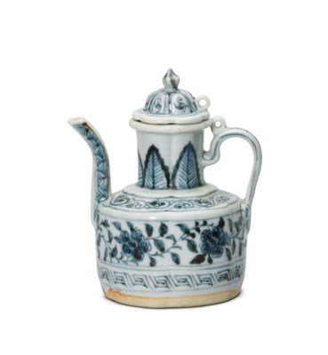 A SMALL BLUE AND WHITE EWER AN