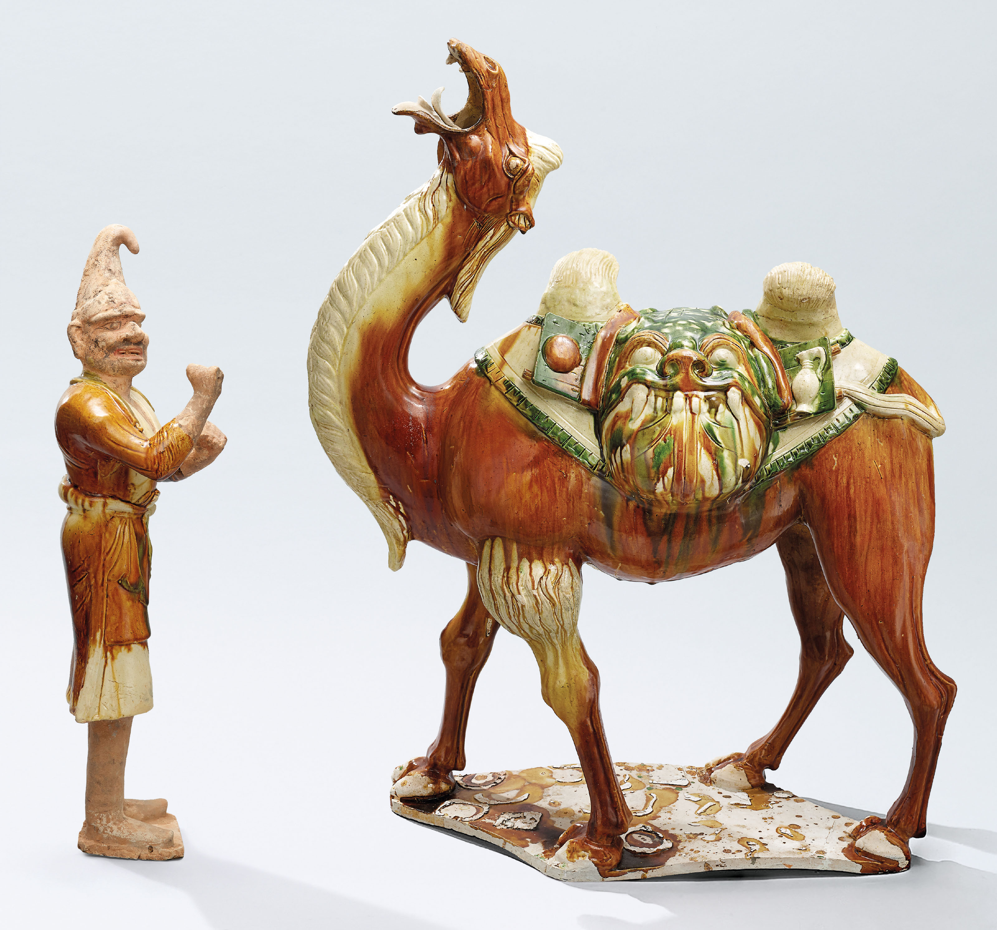 A MAGNIFICENT SANCAI-GLAZED CAMEL AND A FOREIGN ATTENDANT