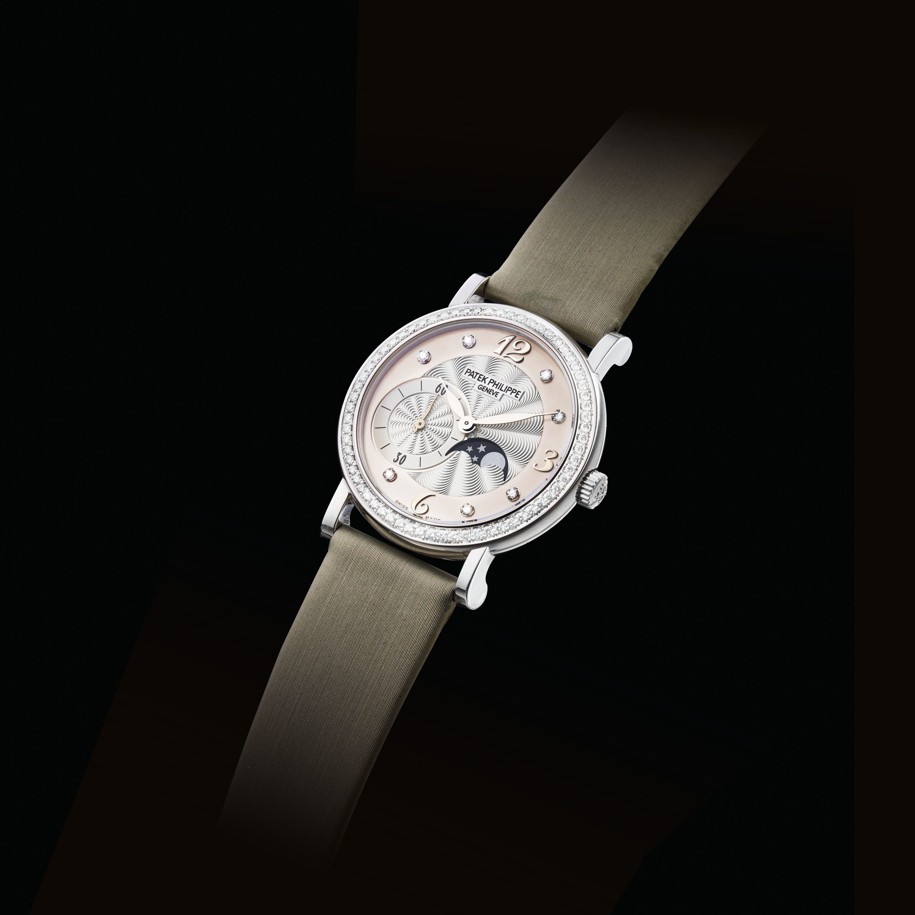 6ab2b07eaf92 PATEK PHILIPPE. A LADY S FINE 18K WHITE GOLD AND DIAMOND-SET WRISTWATCH  WITH MOON PHASES AND MOTHER-OF-PEARL DIAL