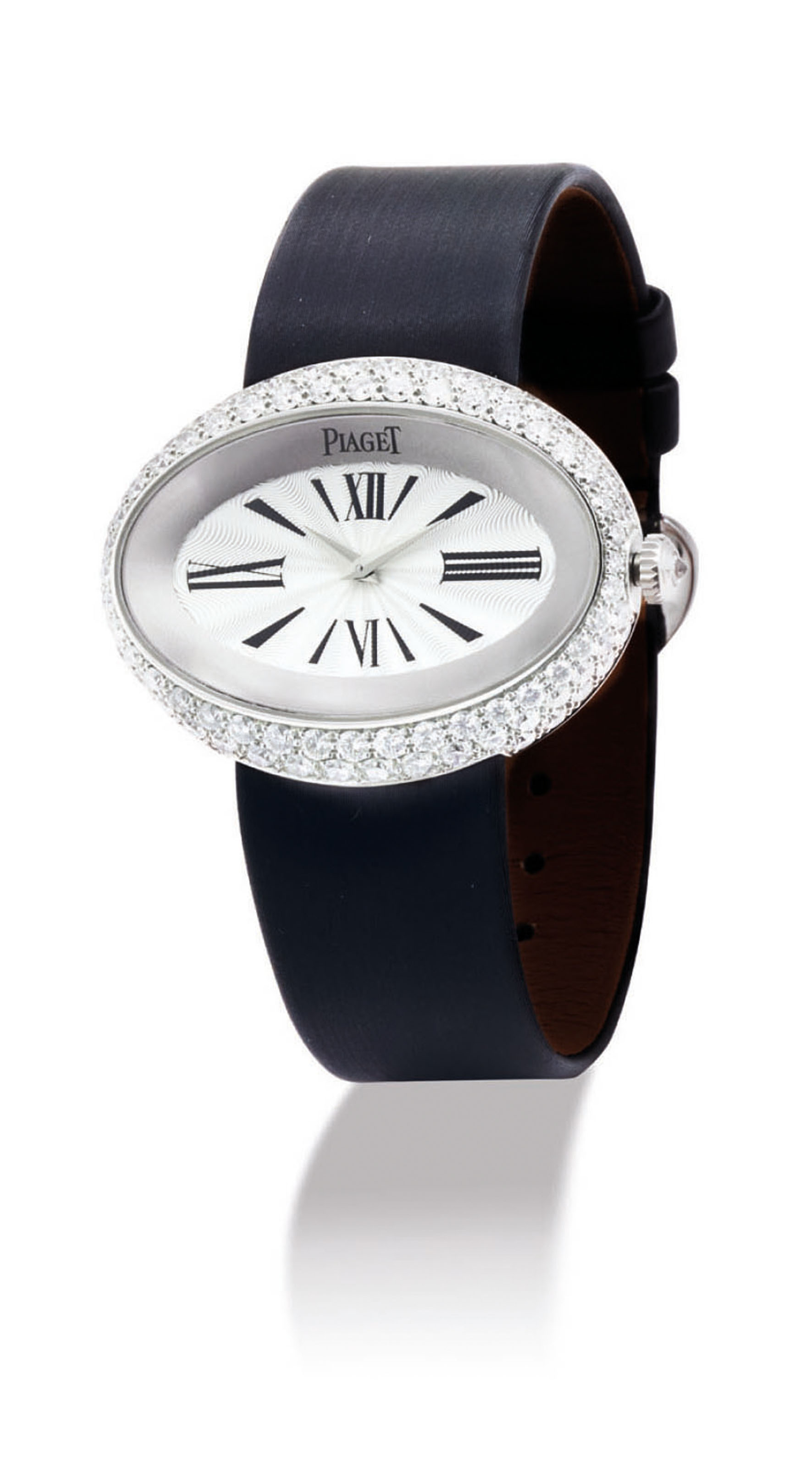PIAGET A LADY'S 18K WHITE GOLD AND DIAMOND-SET OVAL WRISTWAT...