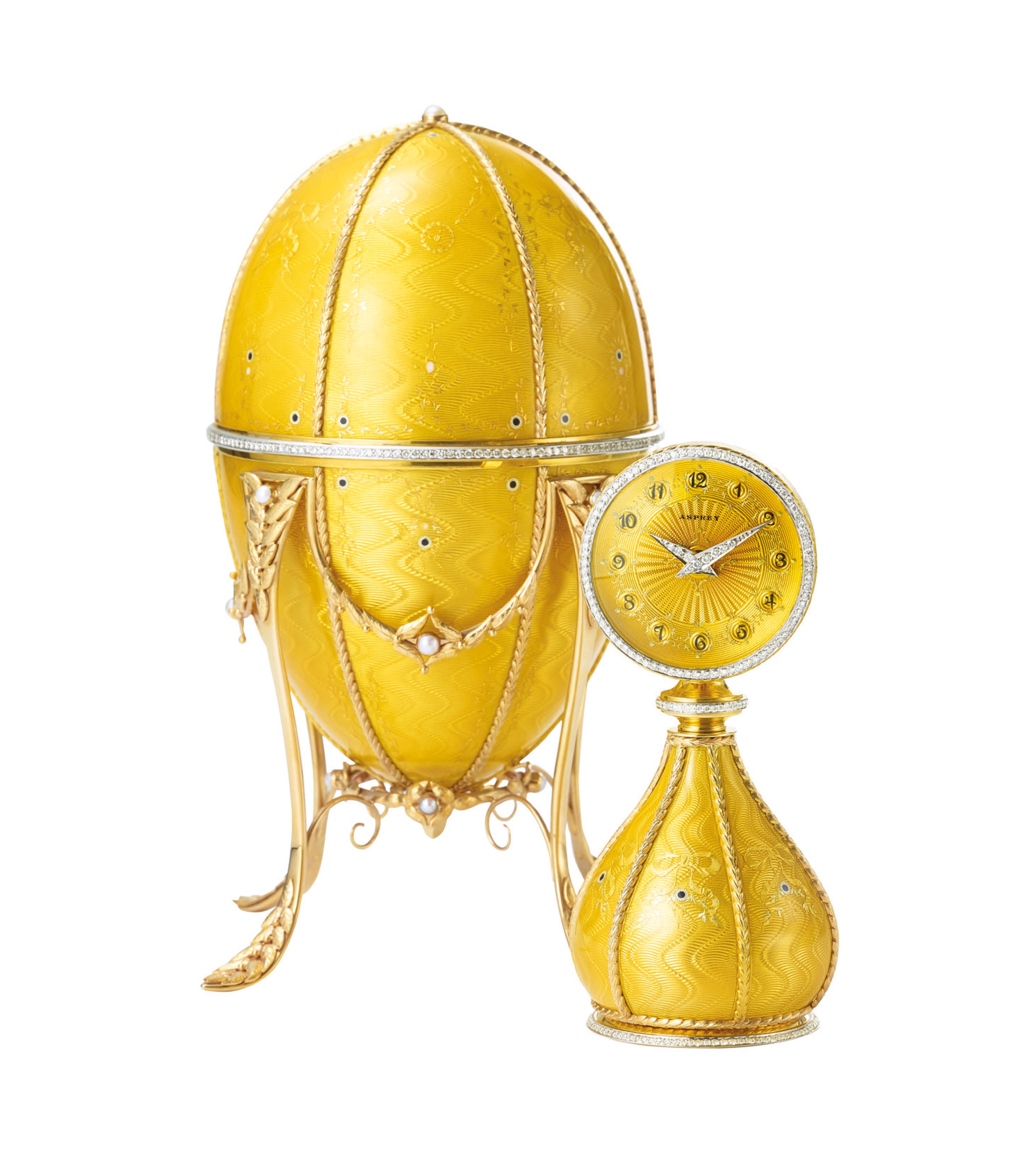 ASPREY. A FINE AND VERY RARE 18K GOLD, ENAMEL, DIAMOND AND PEARL-SET EGG-SHAPED DESK CLOCK