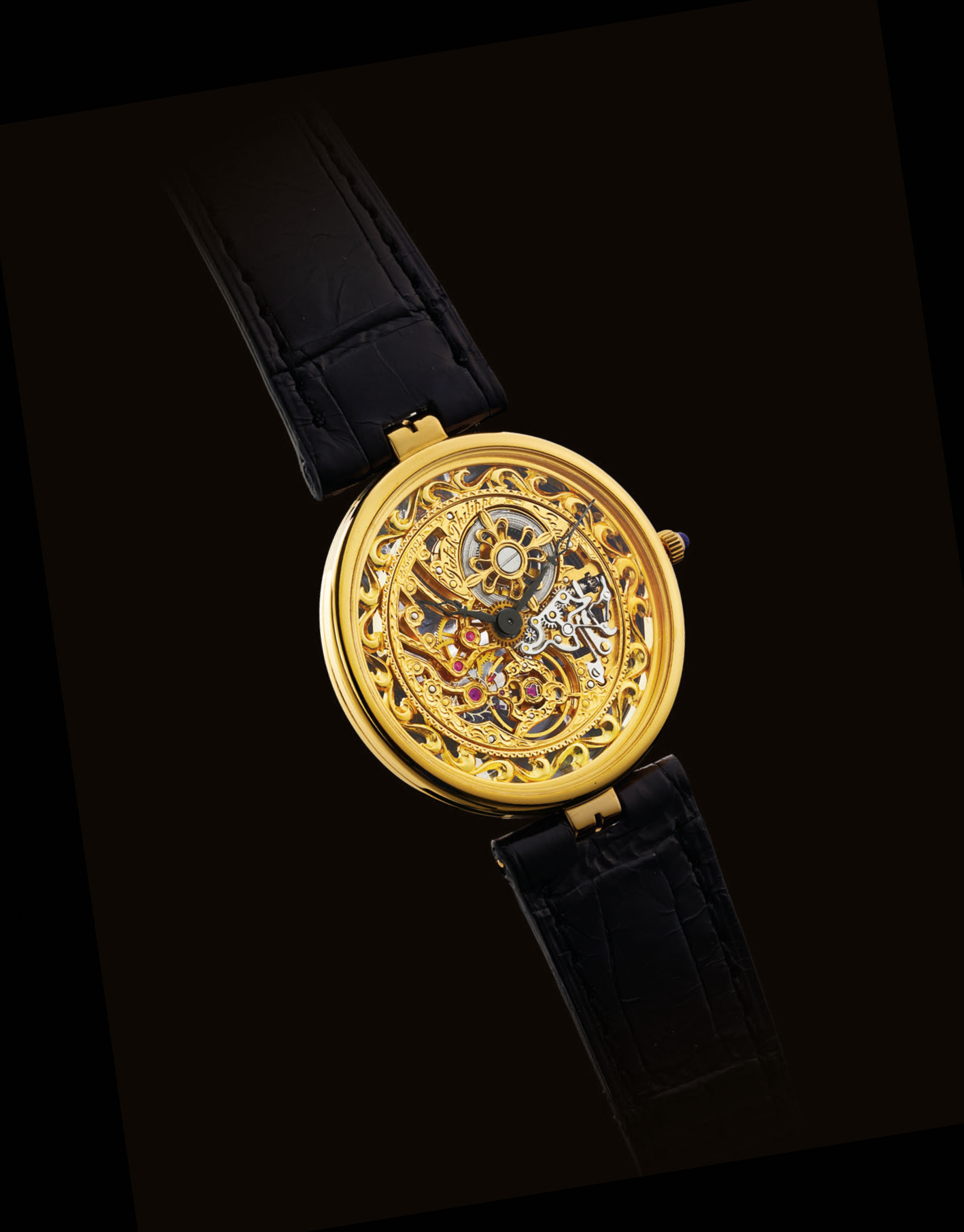 PATEK PHILIPPE. A FINE AND RARE 18K GOLD SKELETONISED WRISTWATCH
