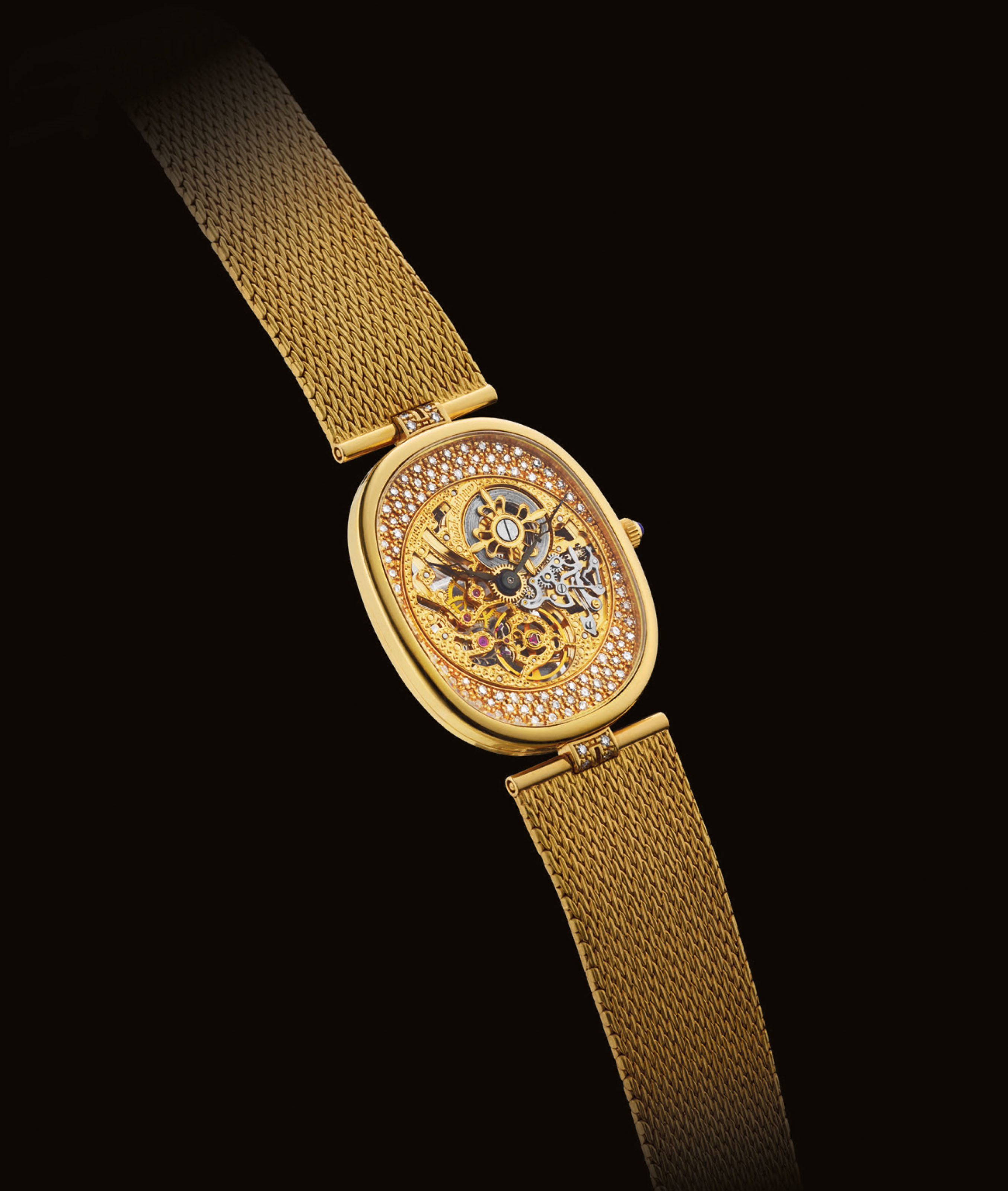 PATEK PHILIPPE. A FINE AND RARE 18K GOLD AND DIAMOND-SET CUSHION-SHAPED SKELETONISED WRISTWATCH WITH BRACELET
