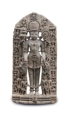 A grey stone figure of Vishnu