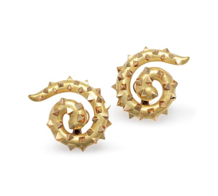 A PAIR OF GOLD SWIRL EAR CLIPS