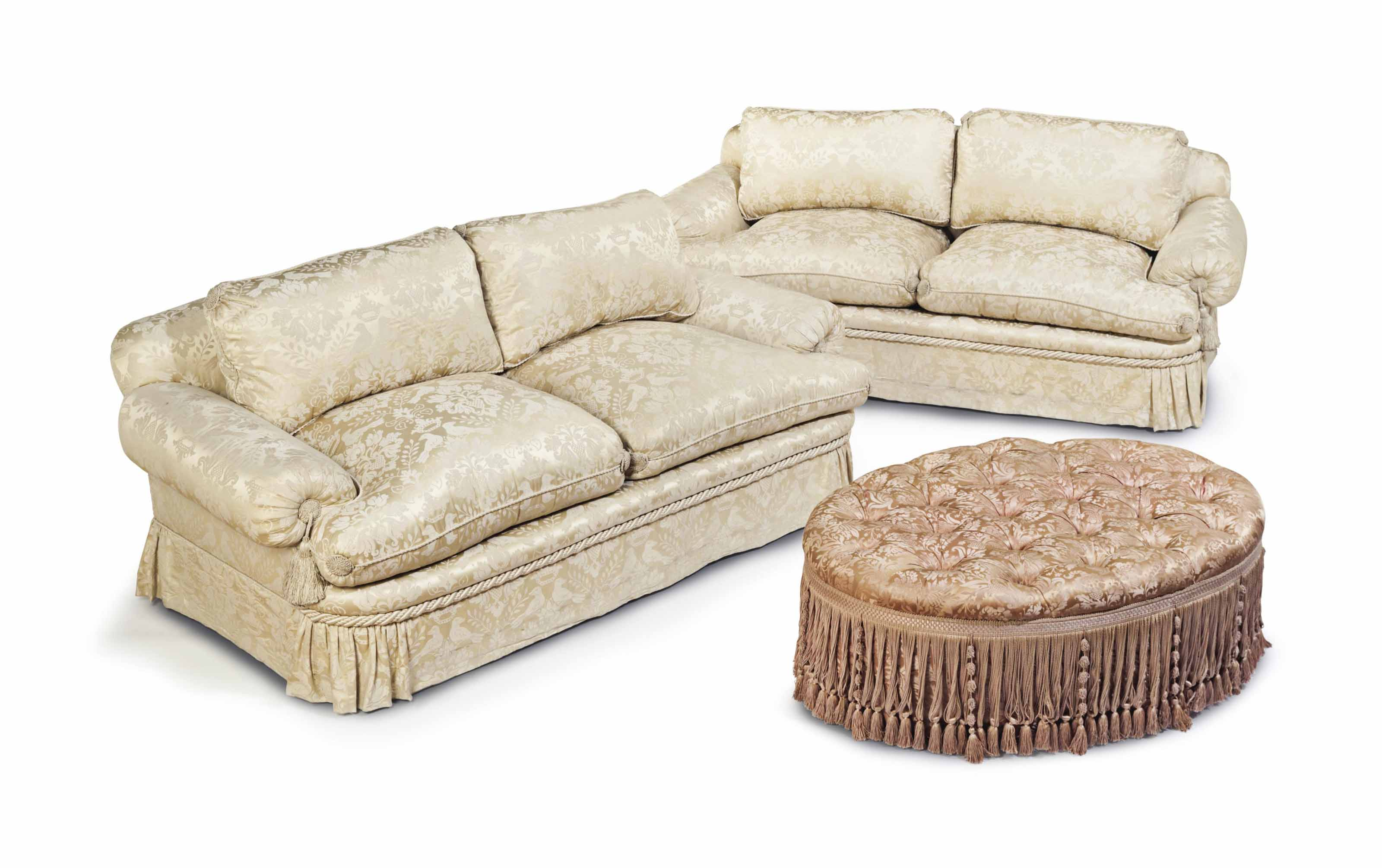 A PAIR OF UPHOLSTERED TWO-CUSH