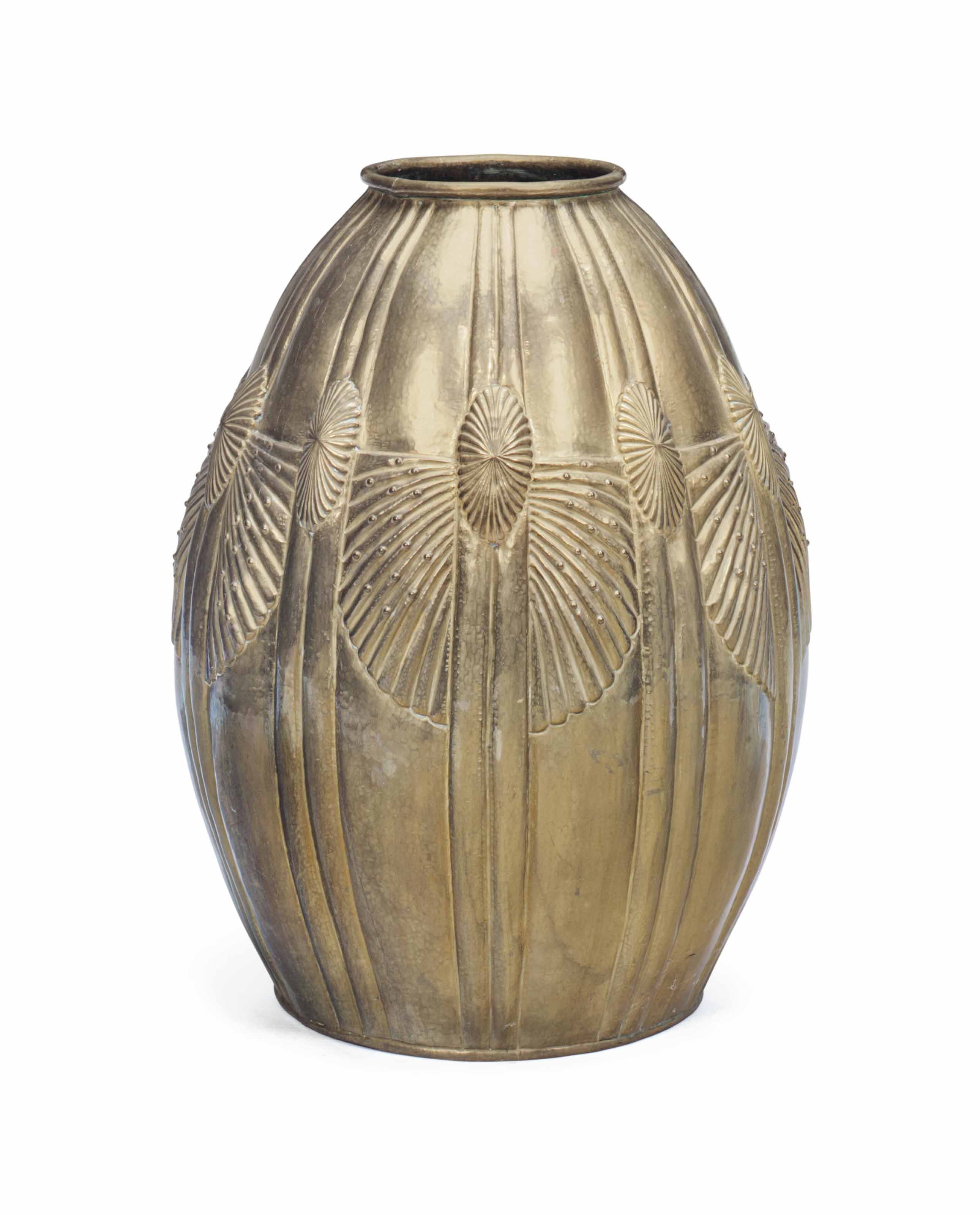 A FRENCH HAMMERED BRASS URN
