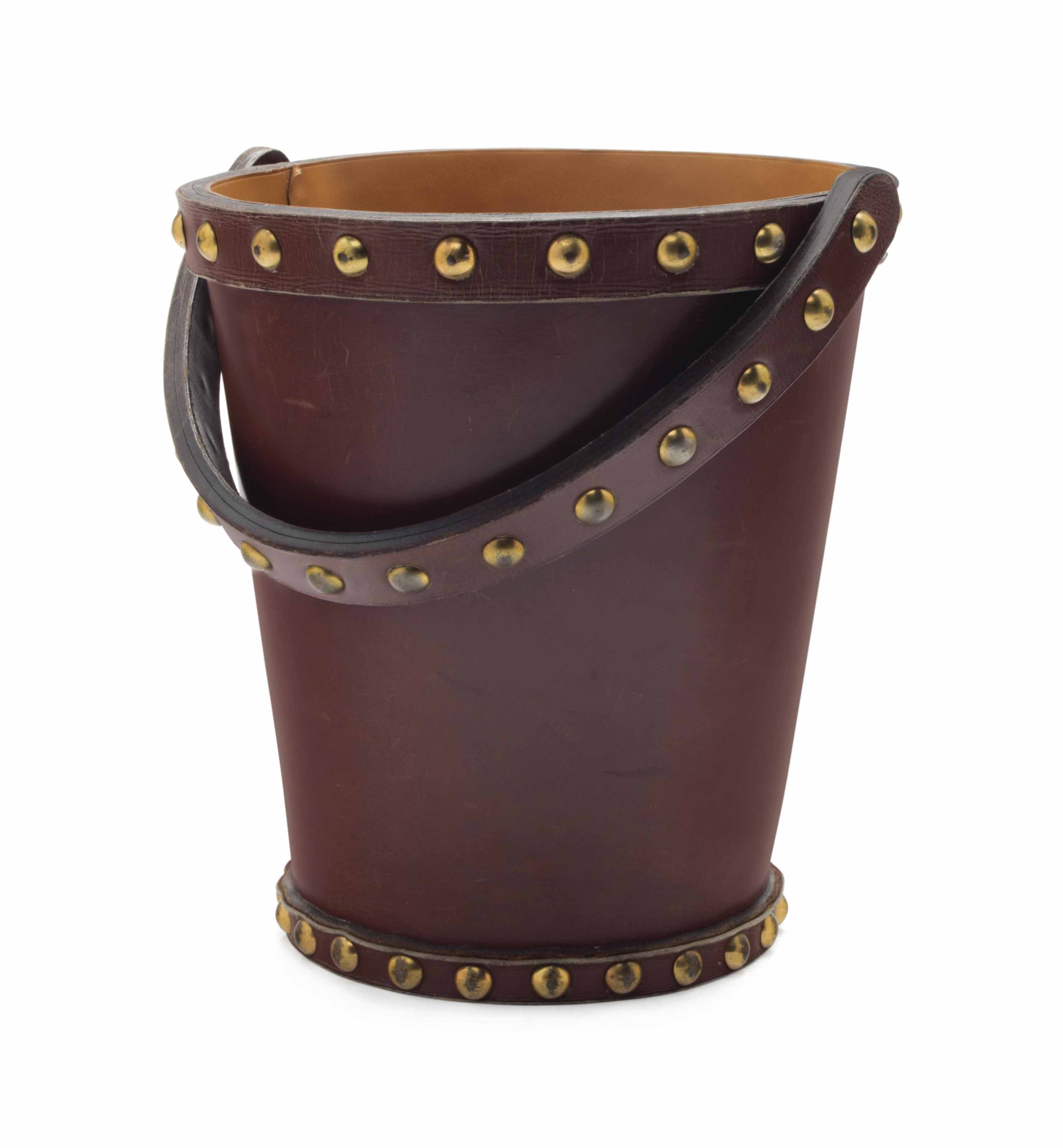 A FRENCH BRASS AND LEATHER WAS