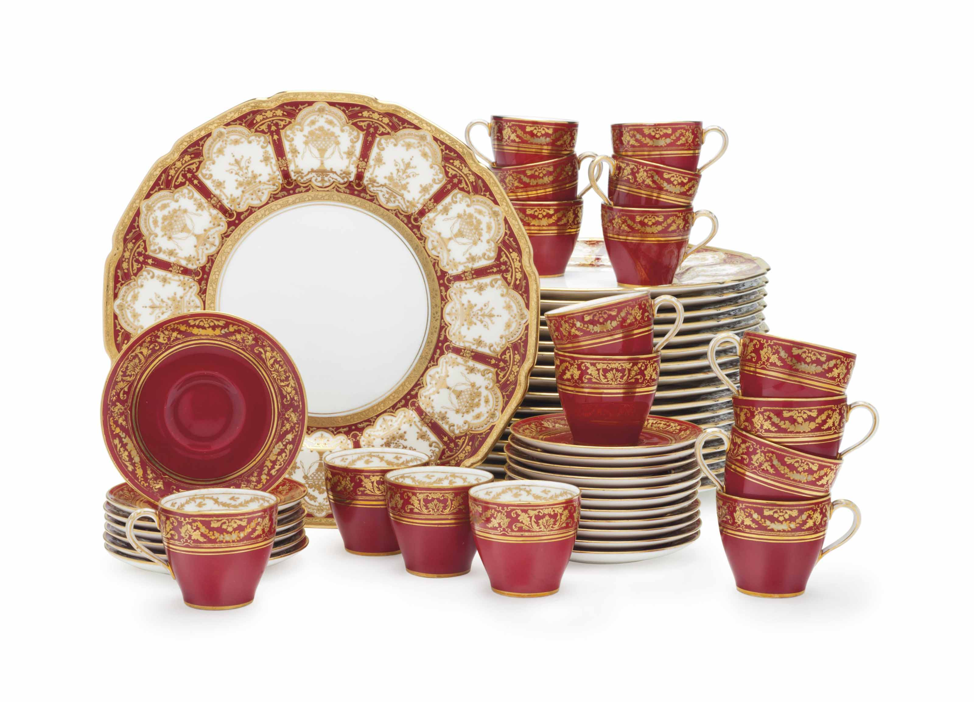 A SET OF EIGHTEEN ROYAL DOULTON PORCELAIN CLARET-GROUND SERVICE PLATES AND EIGHTEEN COFFEE CUPS AND SAUCERS