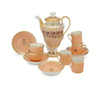 A PARIS PORCELAIN CUSTARD-GROUND COFFEE-POT AND COVER AND SIX PARIS (NAST) APRICOT-GROUND 'CRACKED ICE' ARMORIAL CUPS AND SAUCERS