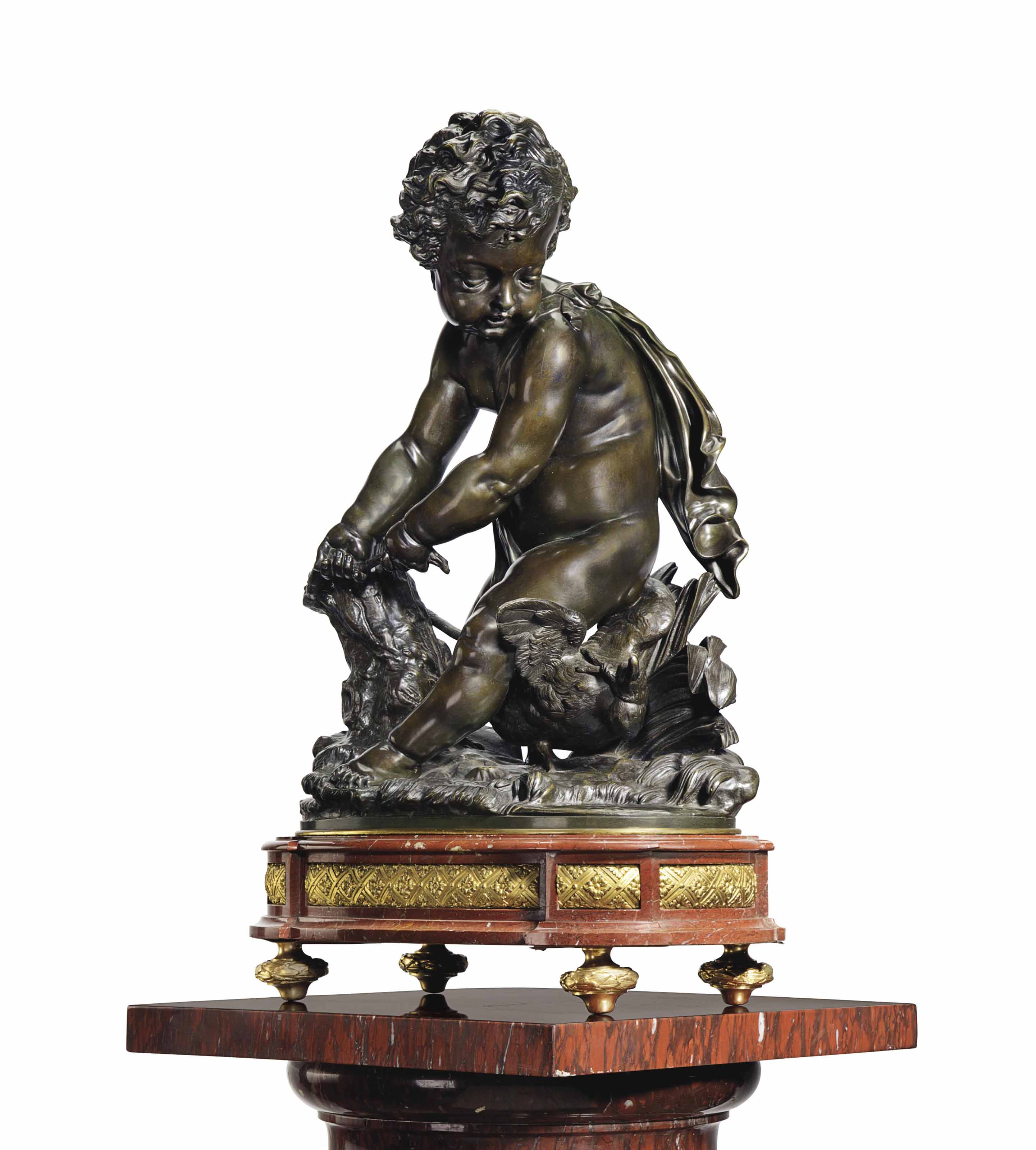 A FRENCH ORMOLU, PATINATED BRONZE AND ROUGE MARBLE FIGURE OF A PUTTO HARNASSING A DOVE
