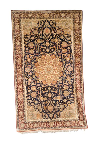 A SILK HEREKE CARPET WITH META