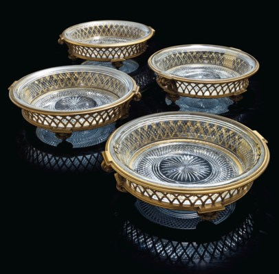 A SET OF FOUR ORMOLU AND CUT-C