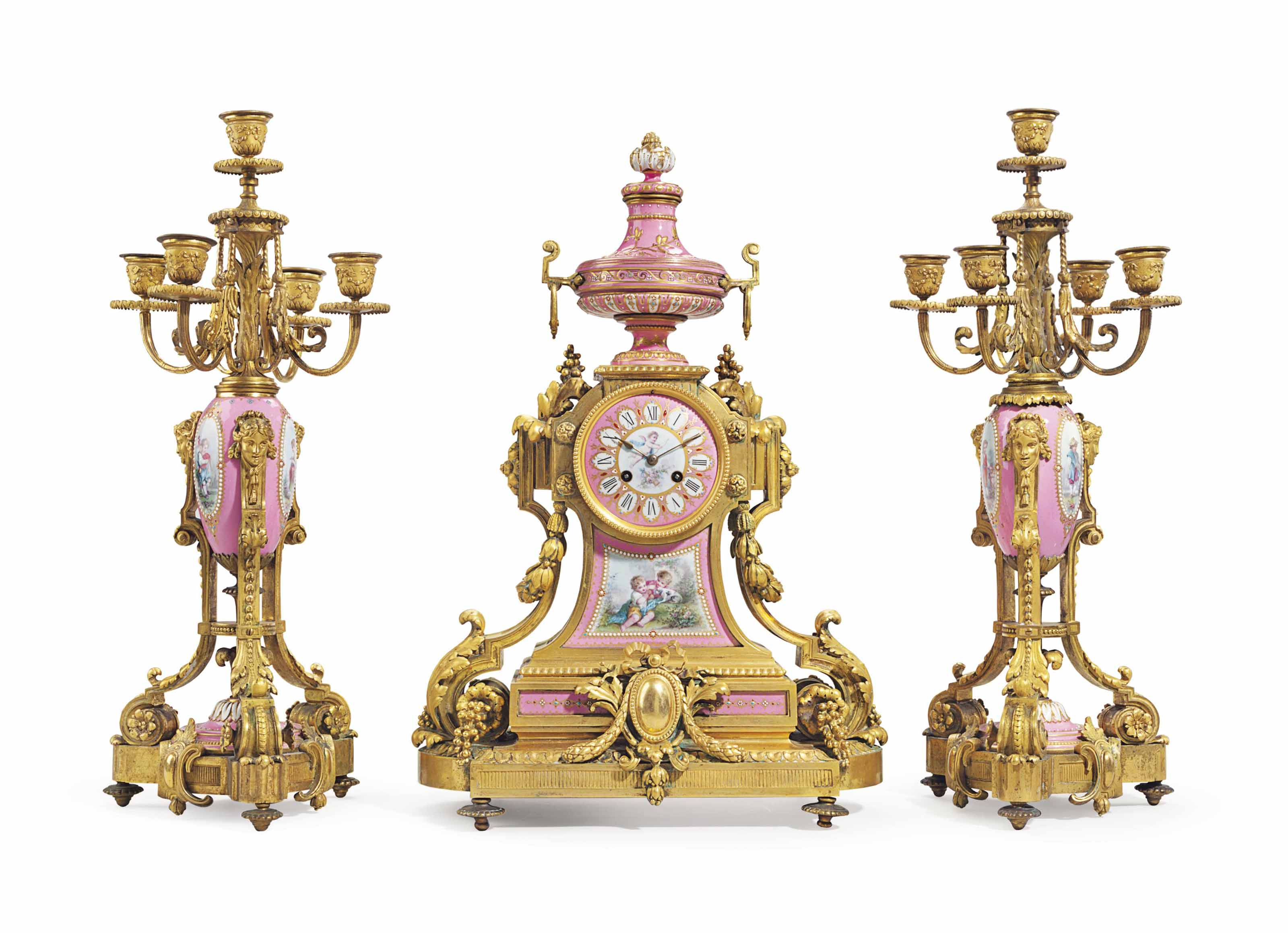 A FRENCH ORMOLU AND SEVRES STYLE PORCELAIN THREE-PIECE CLOCK GARNITURE