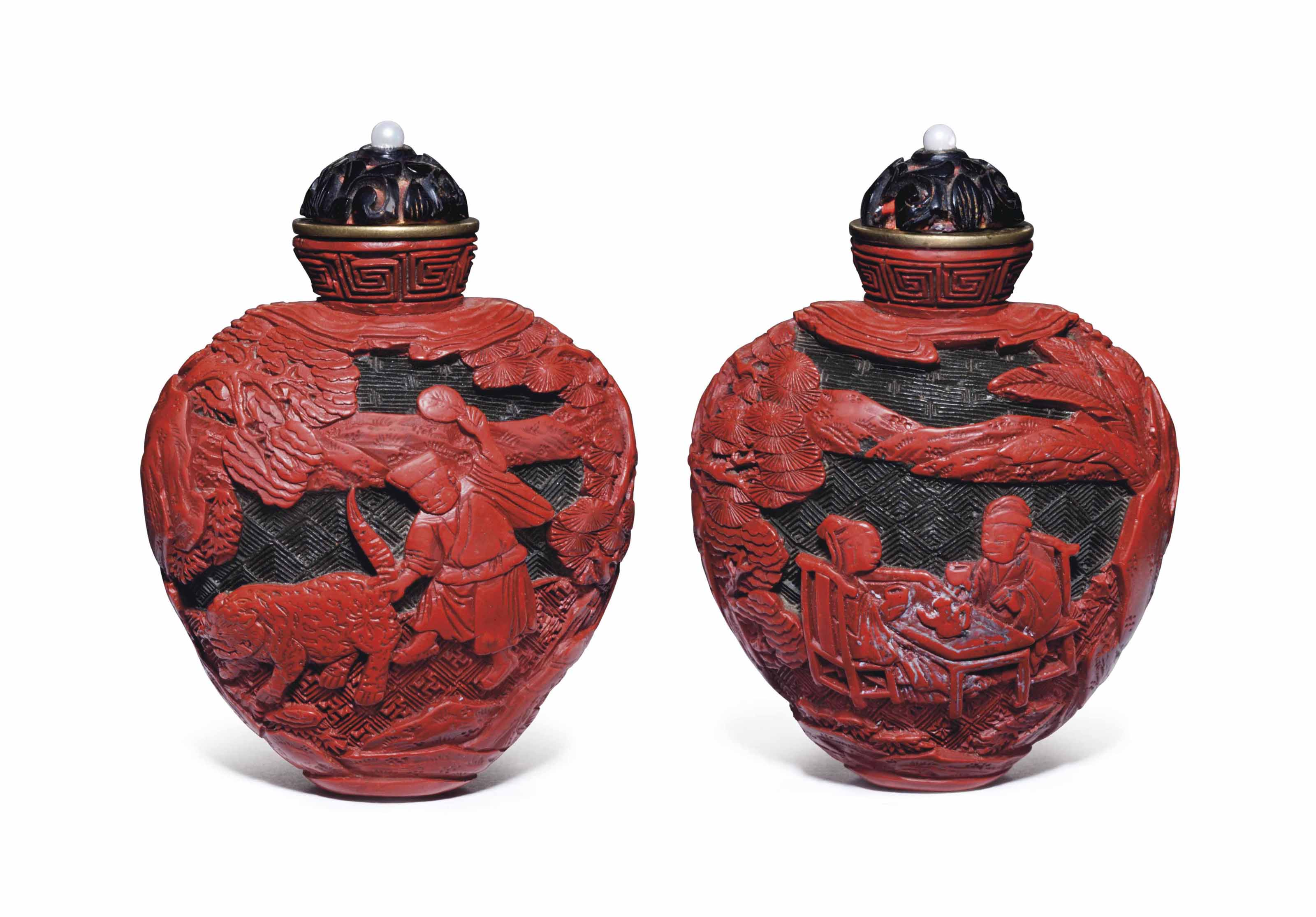 A WELL-CARVED RED AND DARK-GREEN LACQUER SNUFF BOTTLE