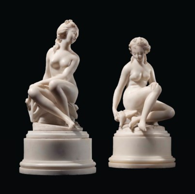 A PAIR OF CARVED MARBLE BATHIN