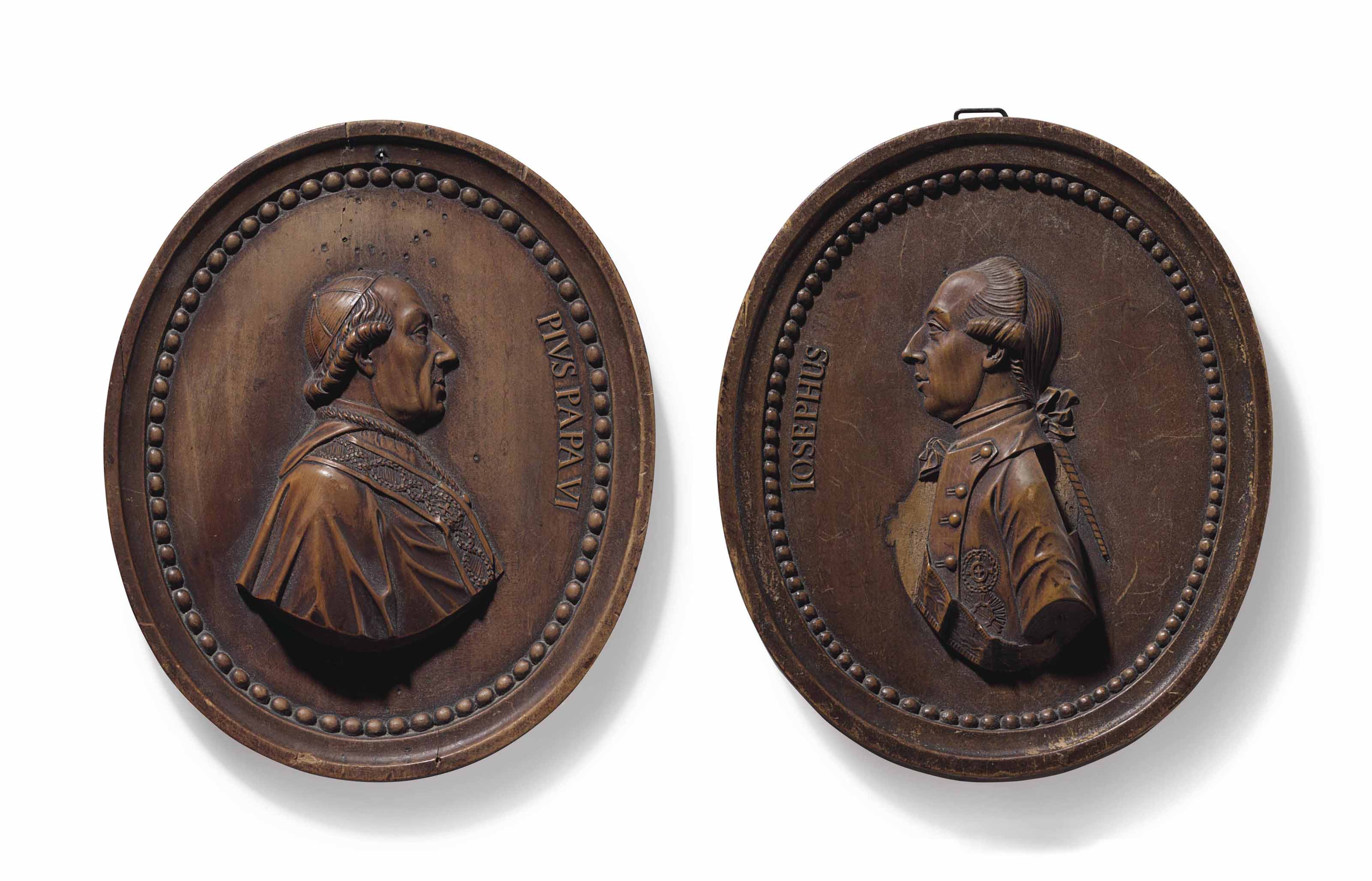 A PAIR OF FRUITWOOD PORTRAIT RELIEFS