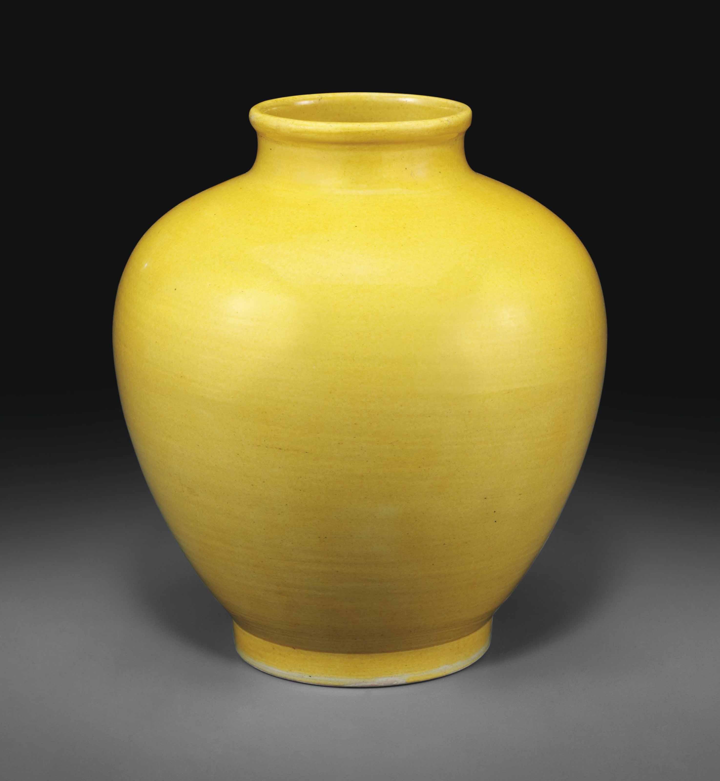 A YELLOW-GLAZED JAR