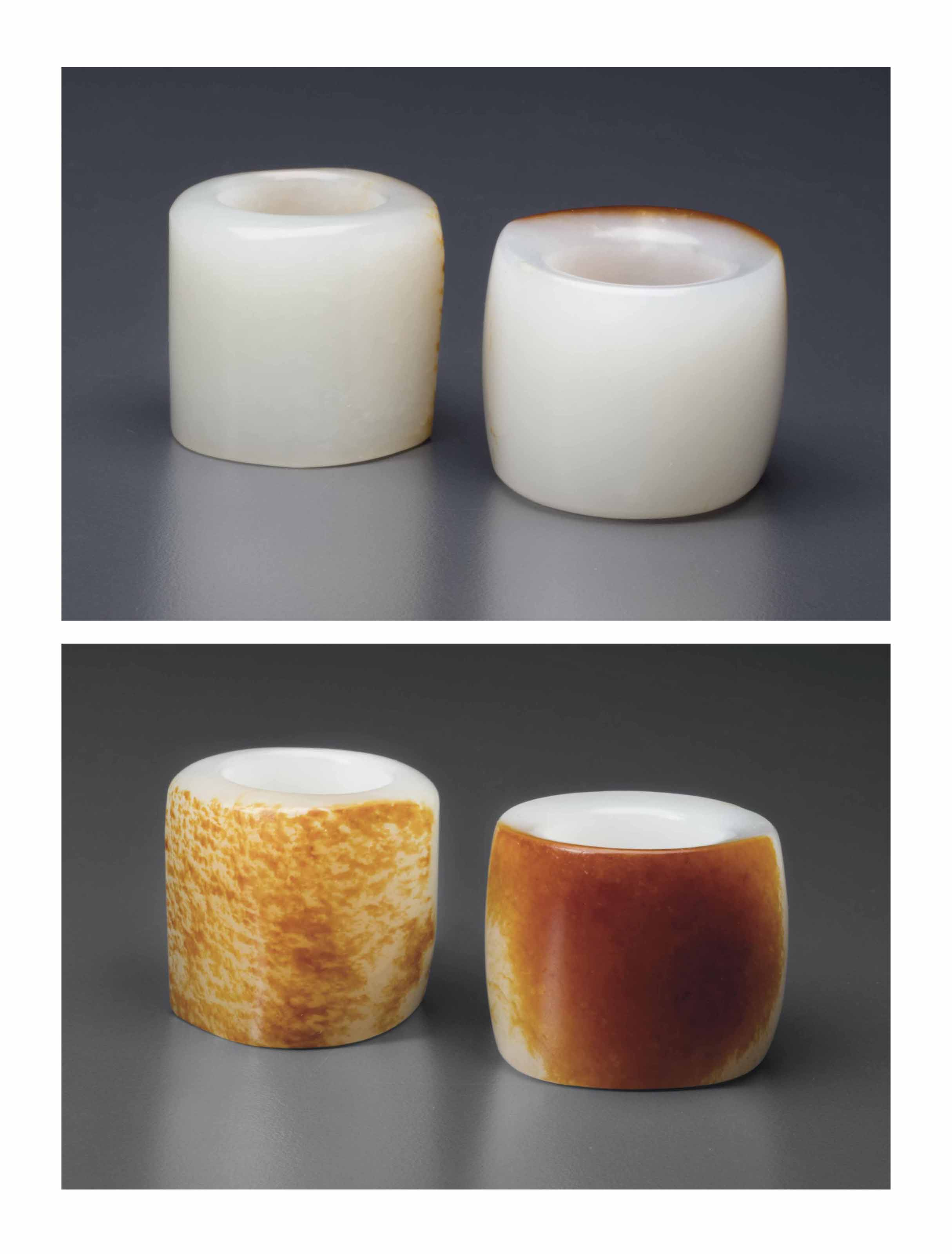 TWO WHITE AND RUSSET JADE THUMB RINGS