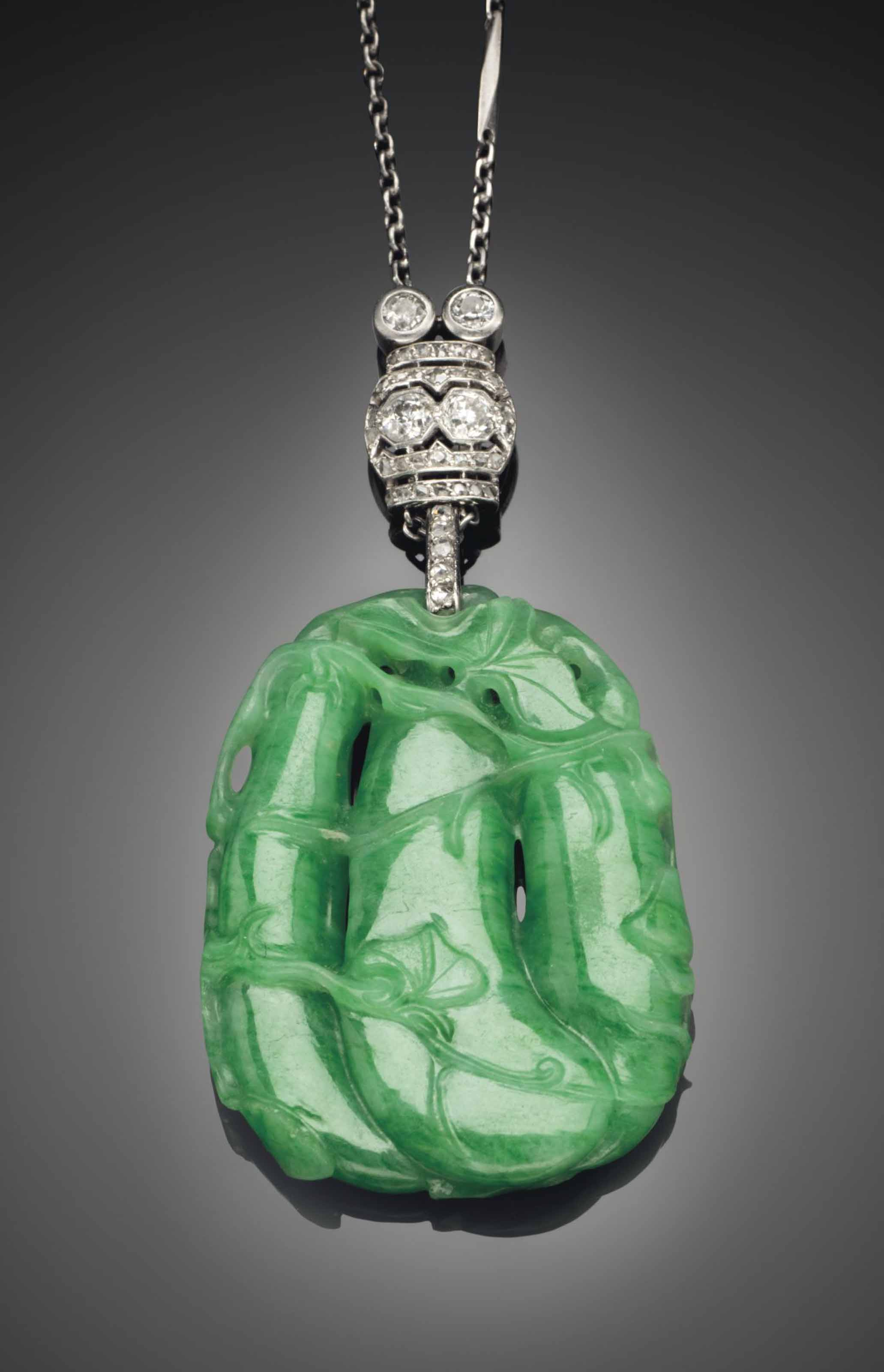 A BRIGHT GREEN JADEITE PENDANT