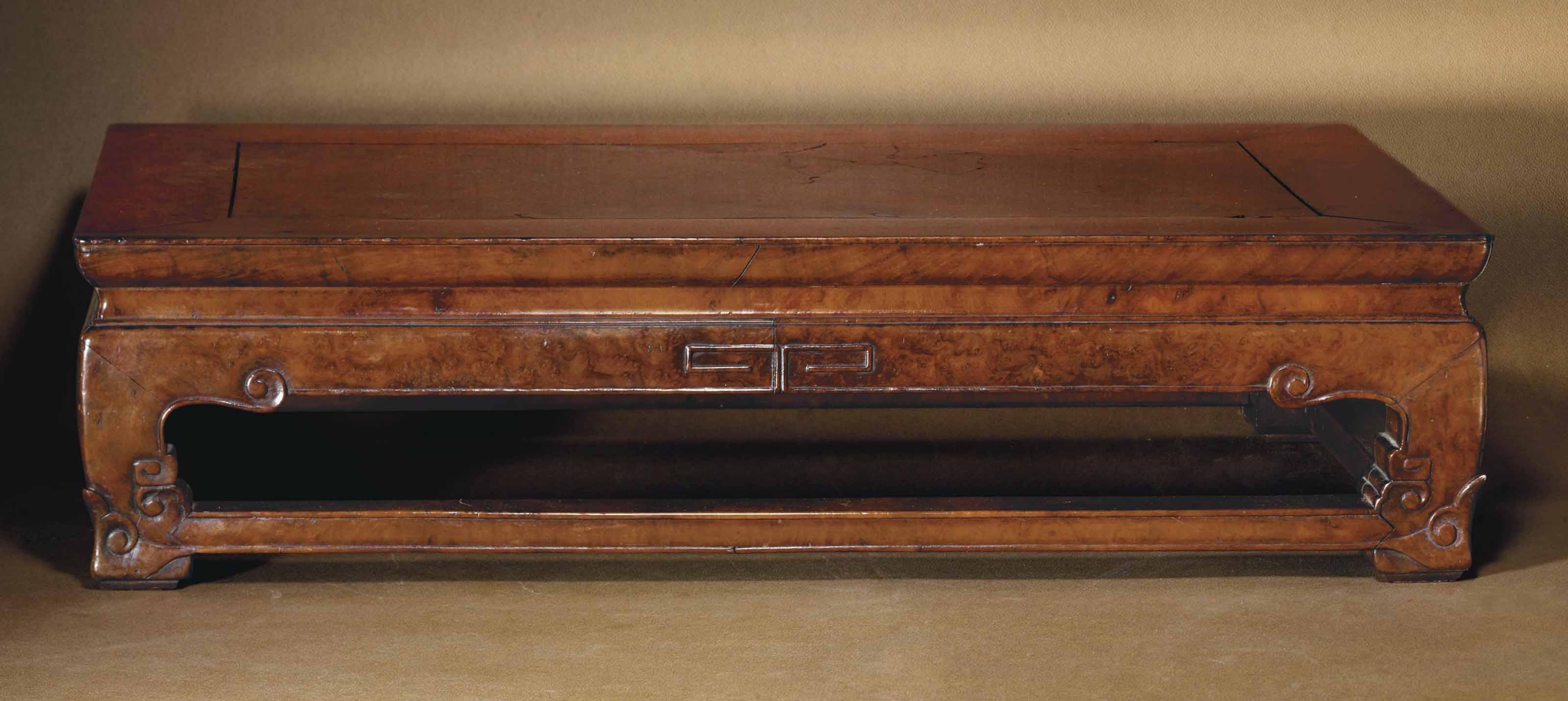 A BURL-VENEERED KANG TABLE