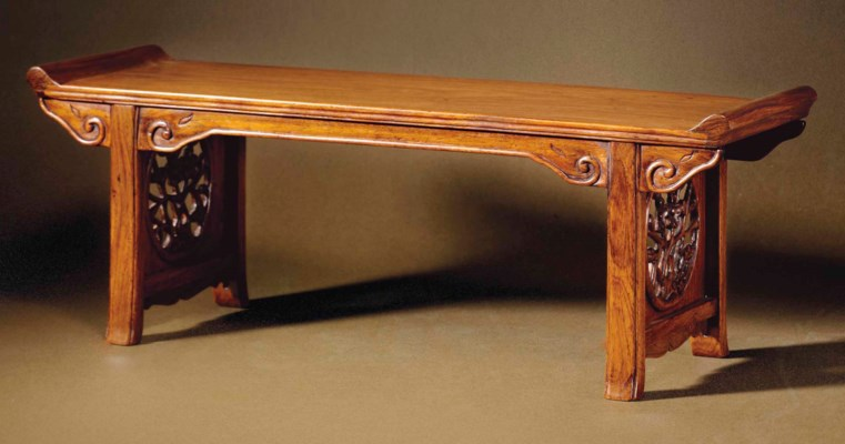 A HUANGHUALI TRESTLE-LEG TABLE