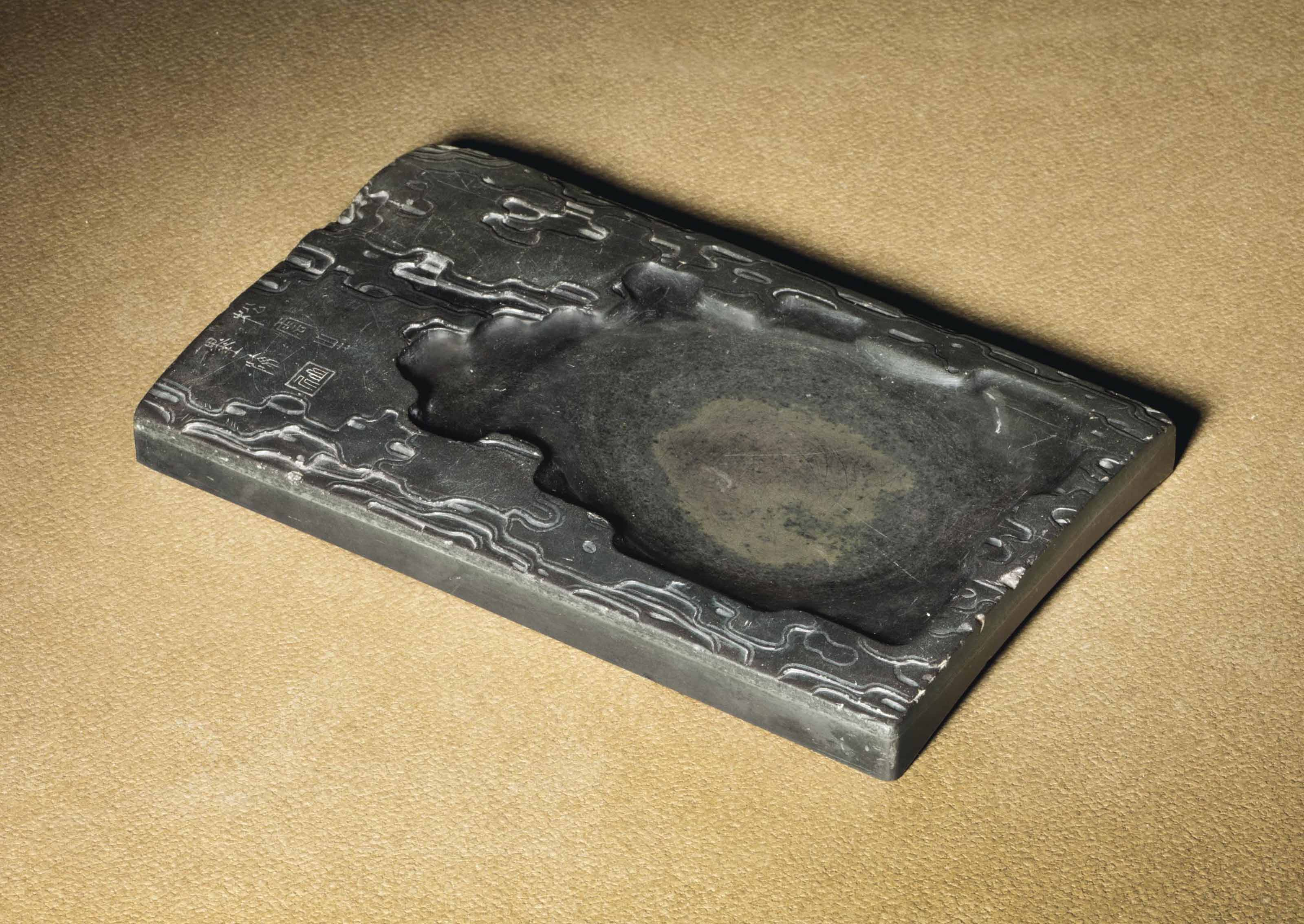 A CARVED DUAN INK STONE