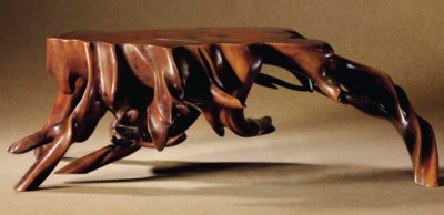A ROOT-FORM BOXWOOD ARM REST
