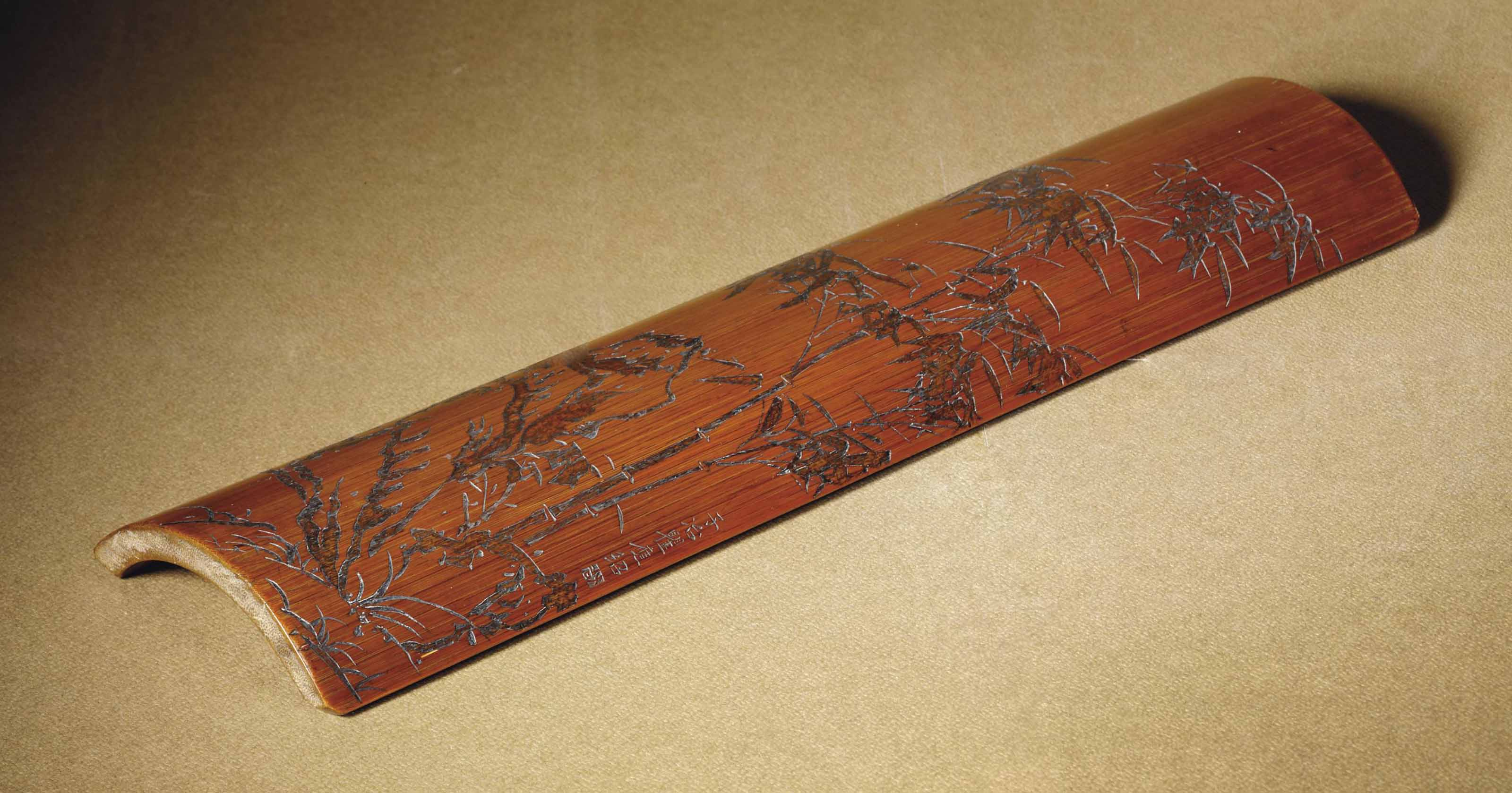 A LARGE CARVED BAMBOO WRIST RE
