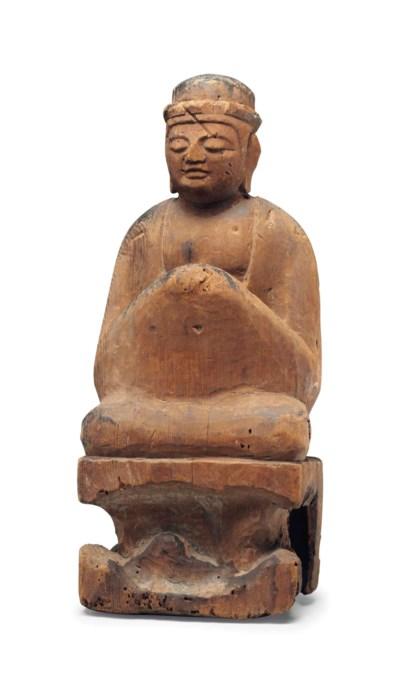 A wood figure of a Shinto Deit