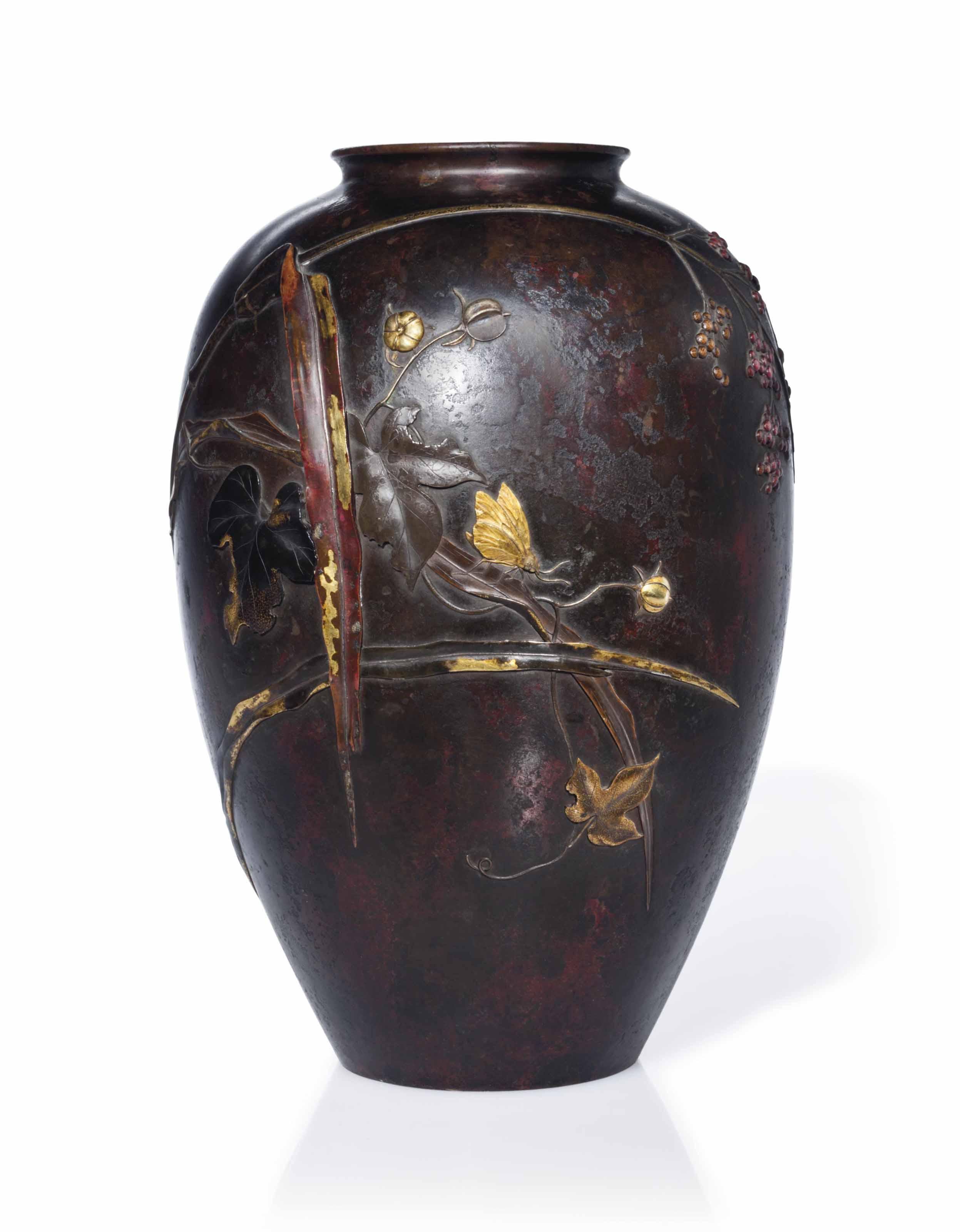 A soft-metal-inlaid bronze vas