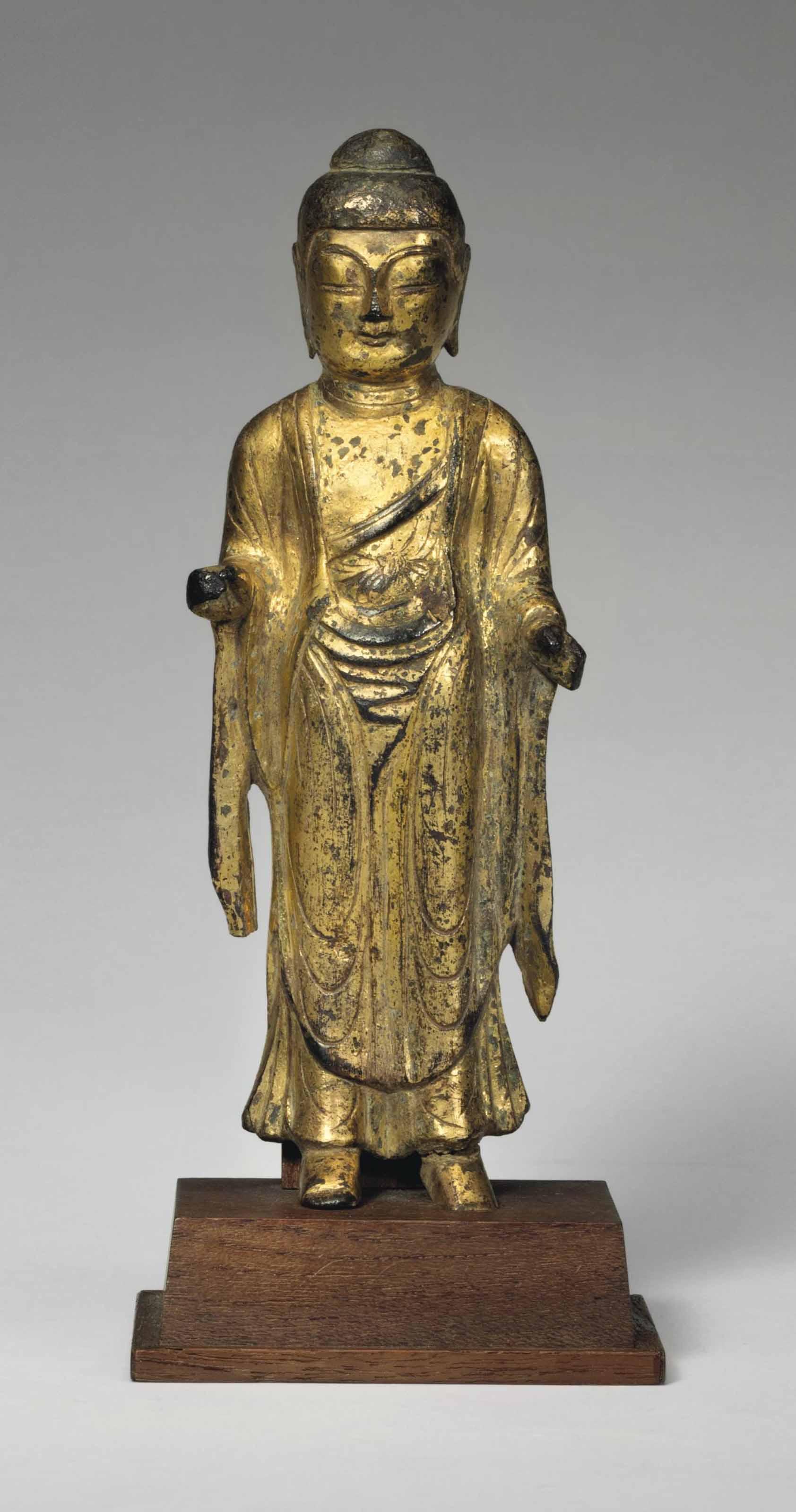 A gilt-bronze standing figure