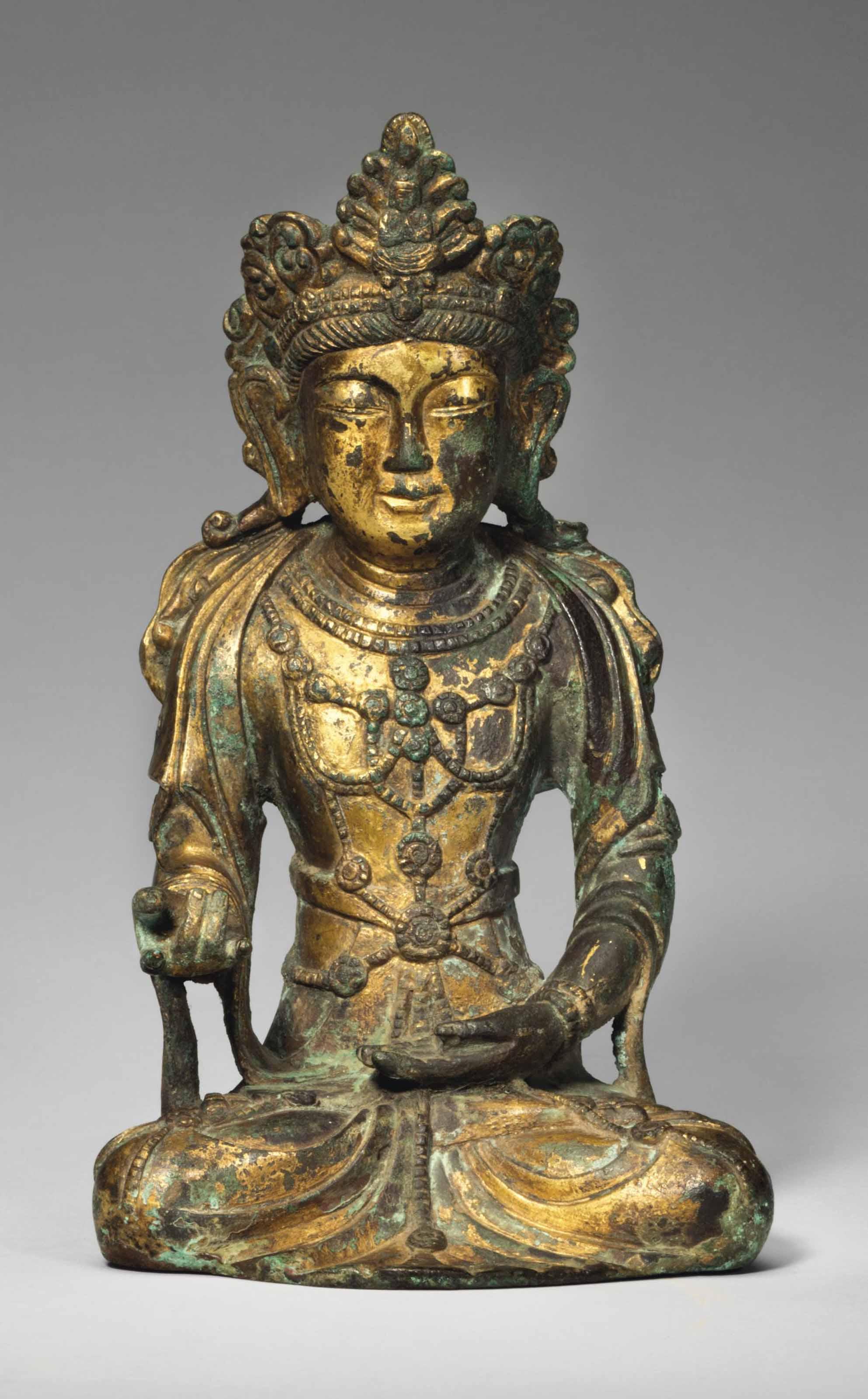 A gilt-bronze seated figure of