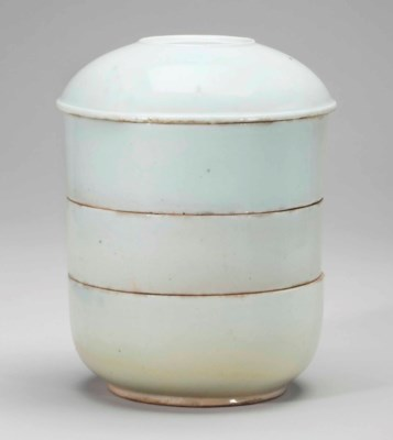 A white porcelain tiered box a