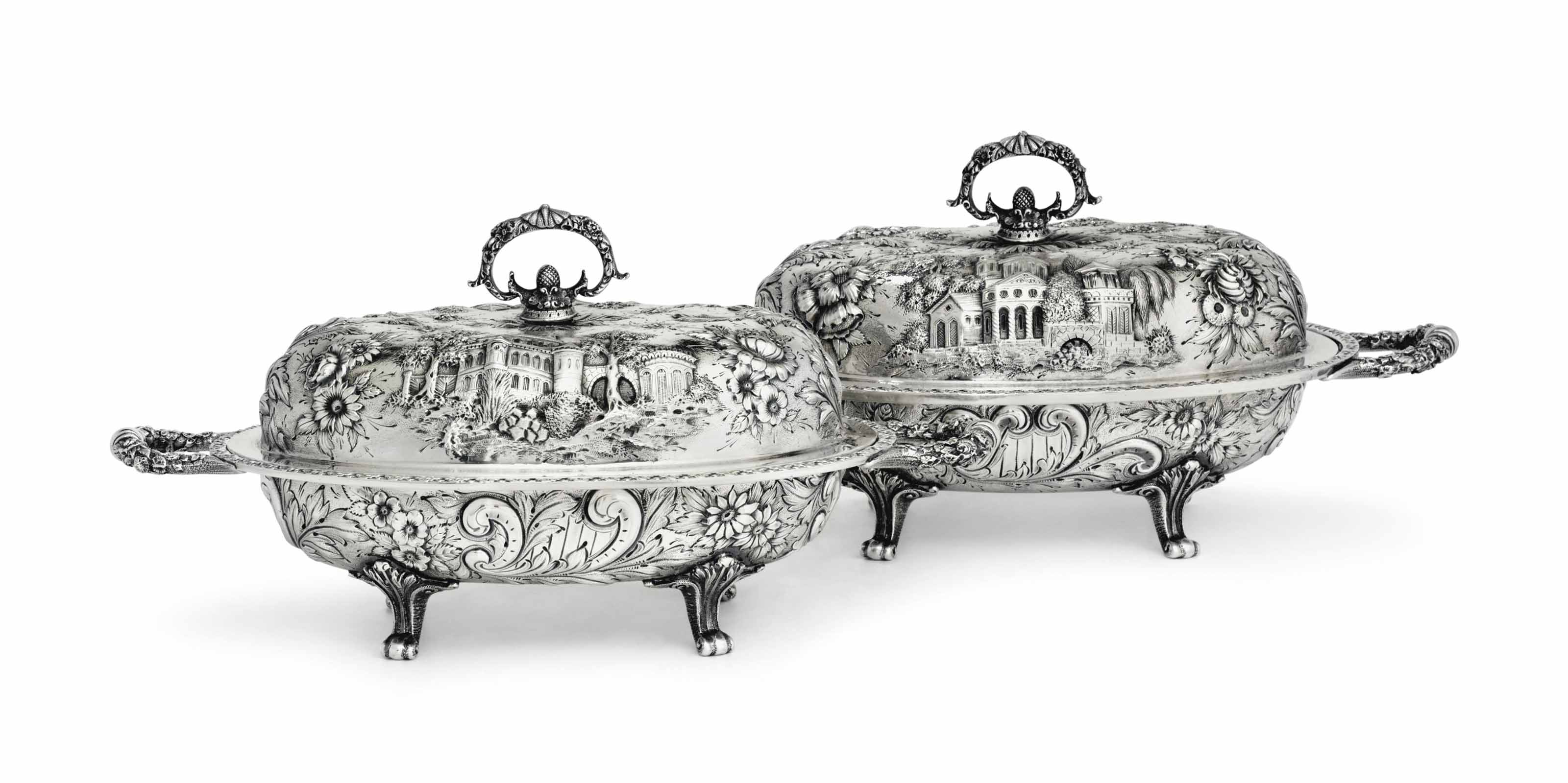 A PAIR OF SILVER VEGETABLE DISHES WITH COVERS
