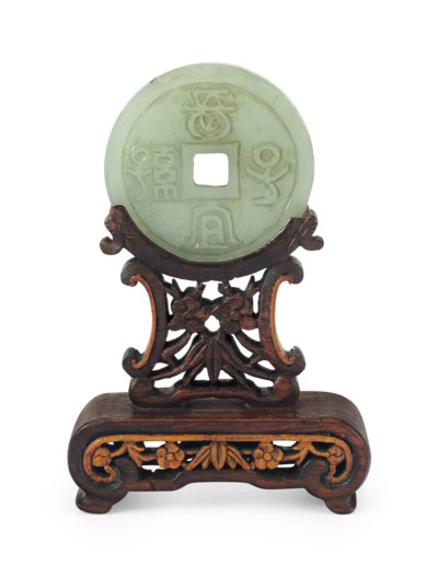A CHINESE CARVED PALE CELADON