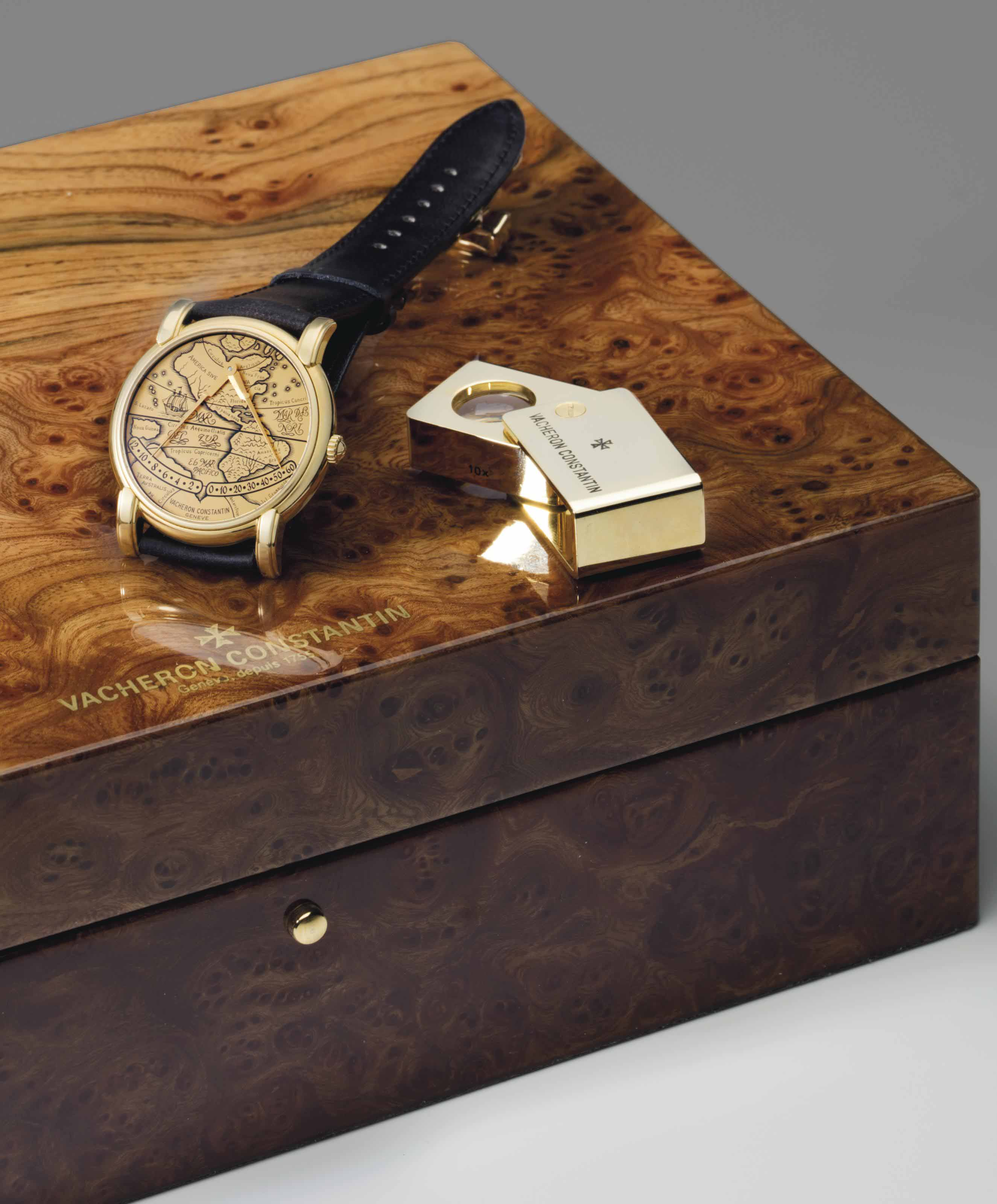 Vacheron Constantin. A Fine 18k Gold Automatic Dual Retrograde Wristwatch with Map of the Americas and Australia