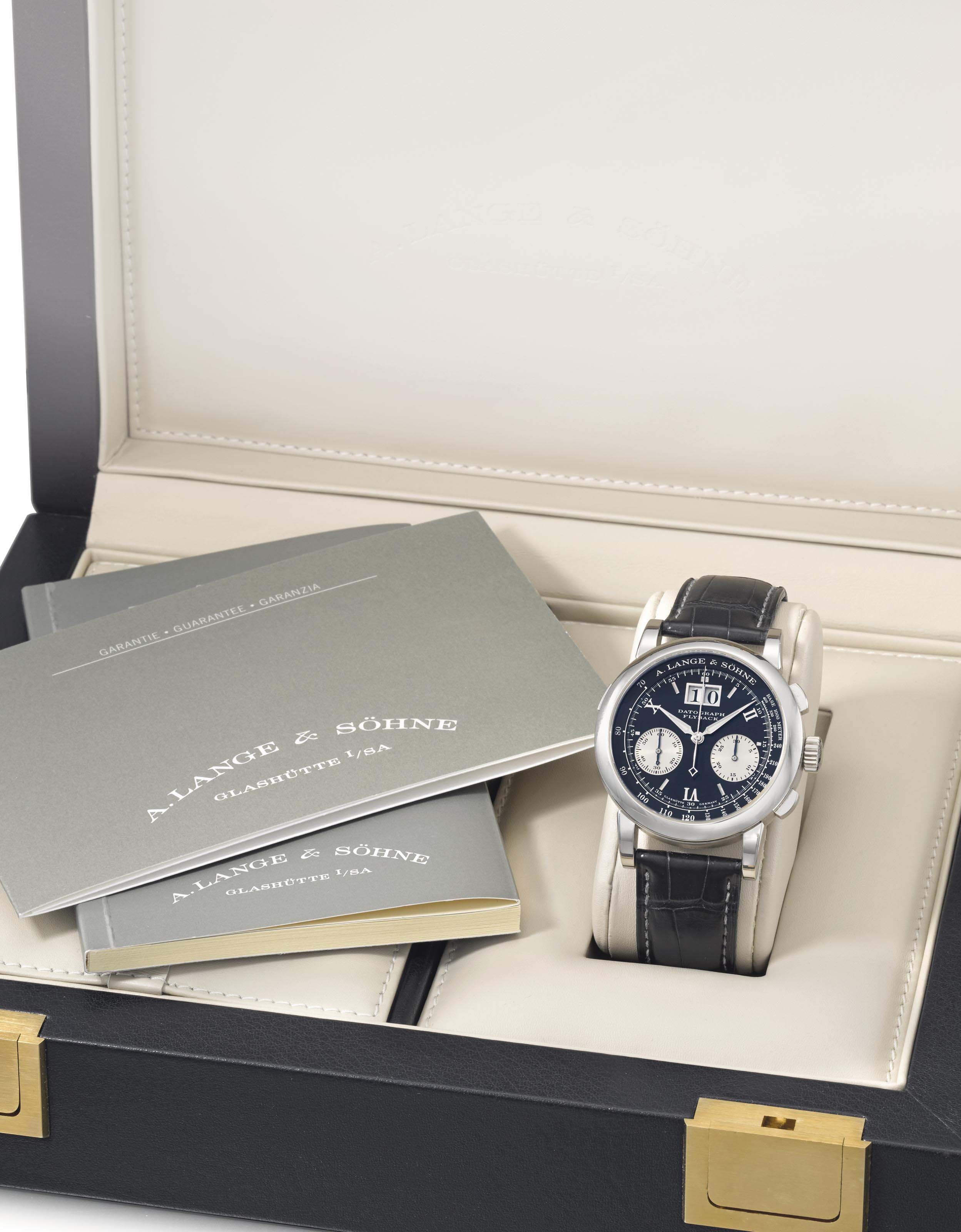 A. Lange & Söhne. A Fine Platinum Flyback Chronograph Wristwatch with Oversized Date