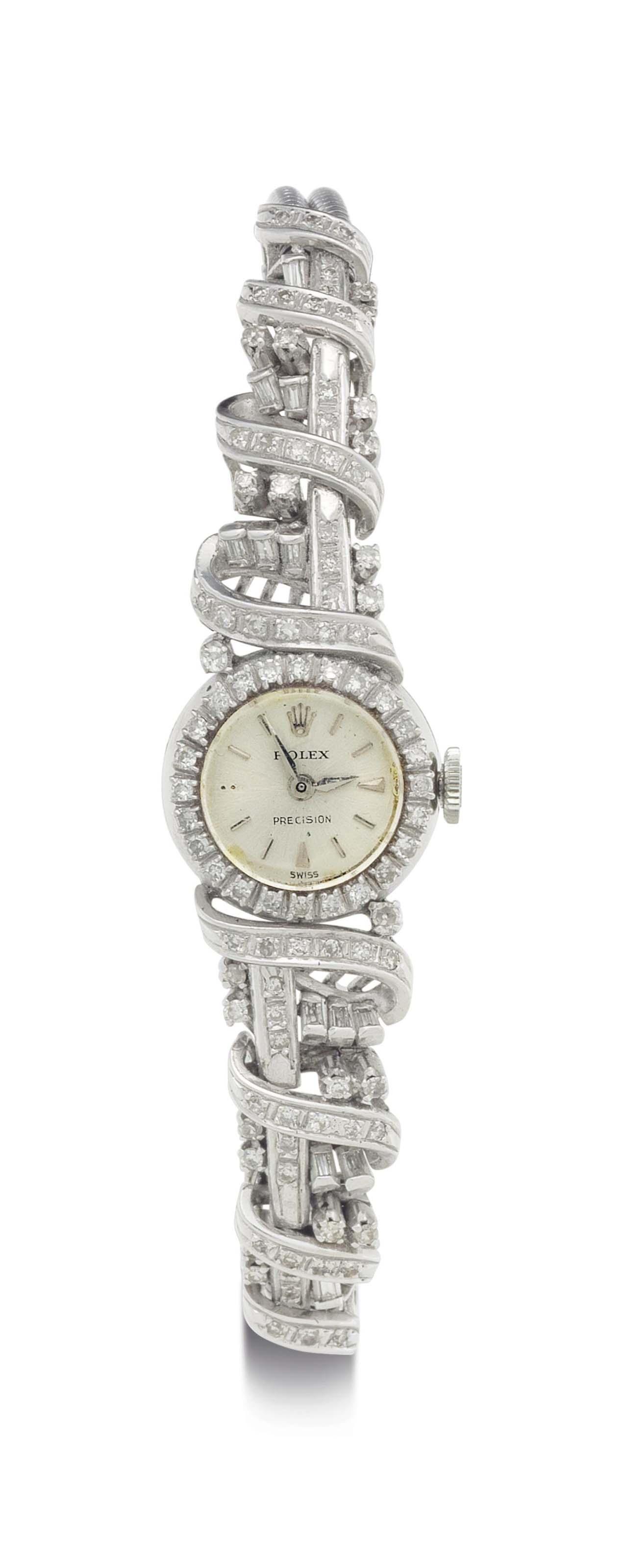 Rolex. A Lady's 18k White Gold and Diamond-Set Bracelet Watch