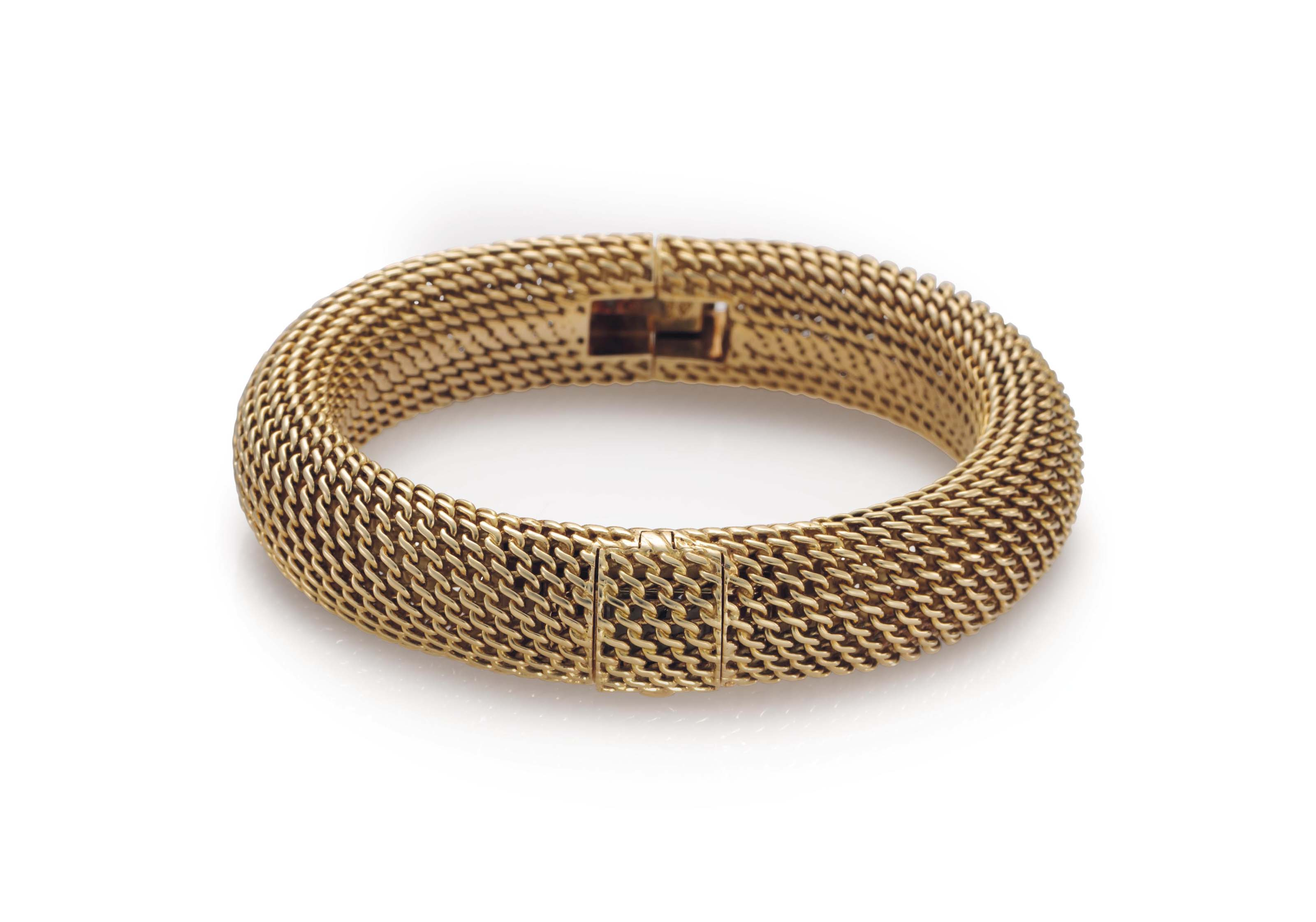 Audemars Piguet. A Lady's Fine 18k Gold Bracelet Watch with Concealed Dial