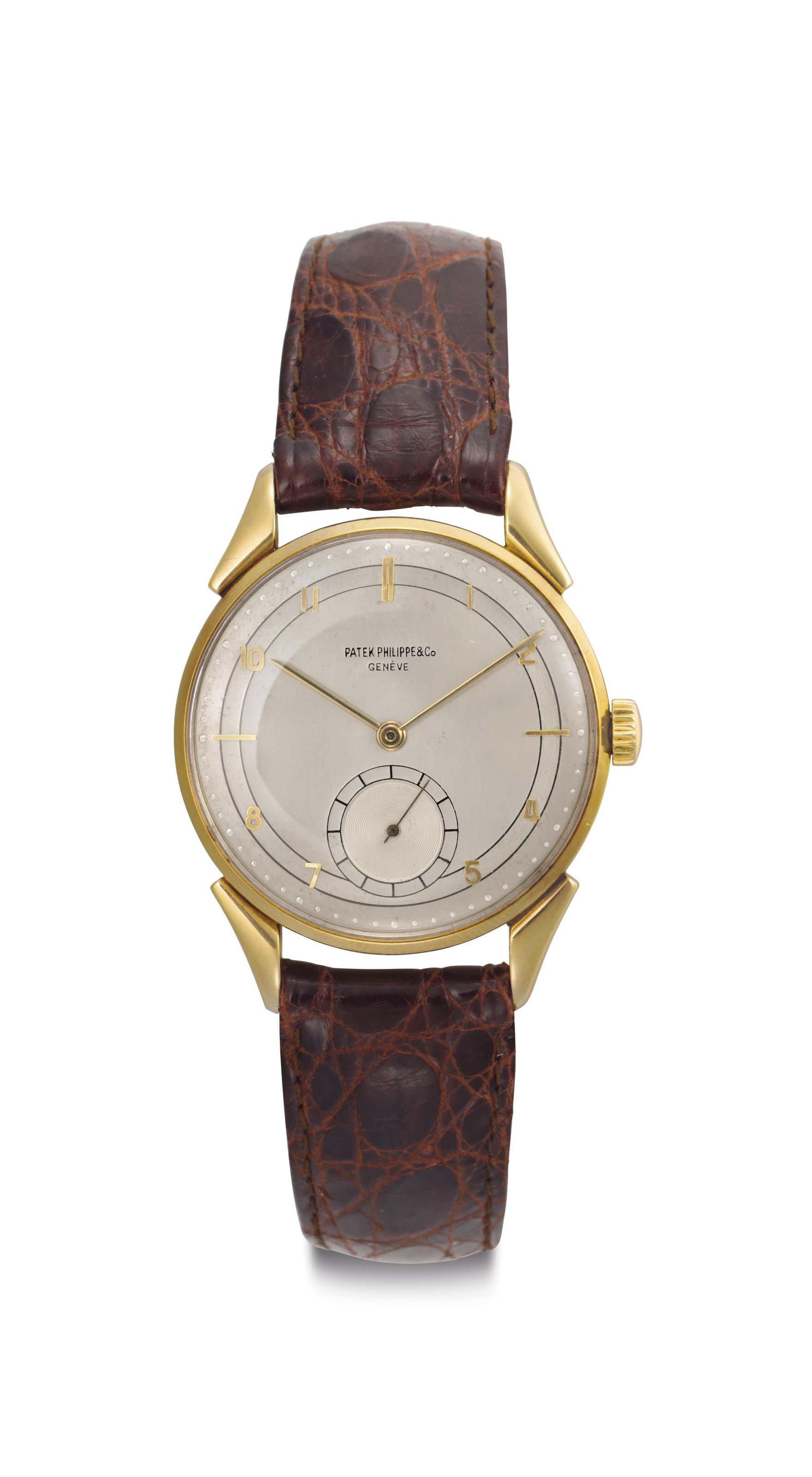 Patek Philippe. A Fine 18k Gold Wristwatch with Two-Tone Dial and Fancy Lugs